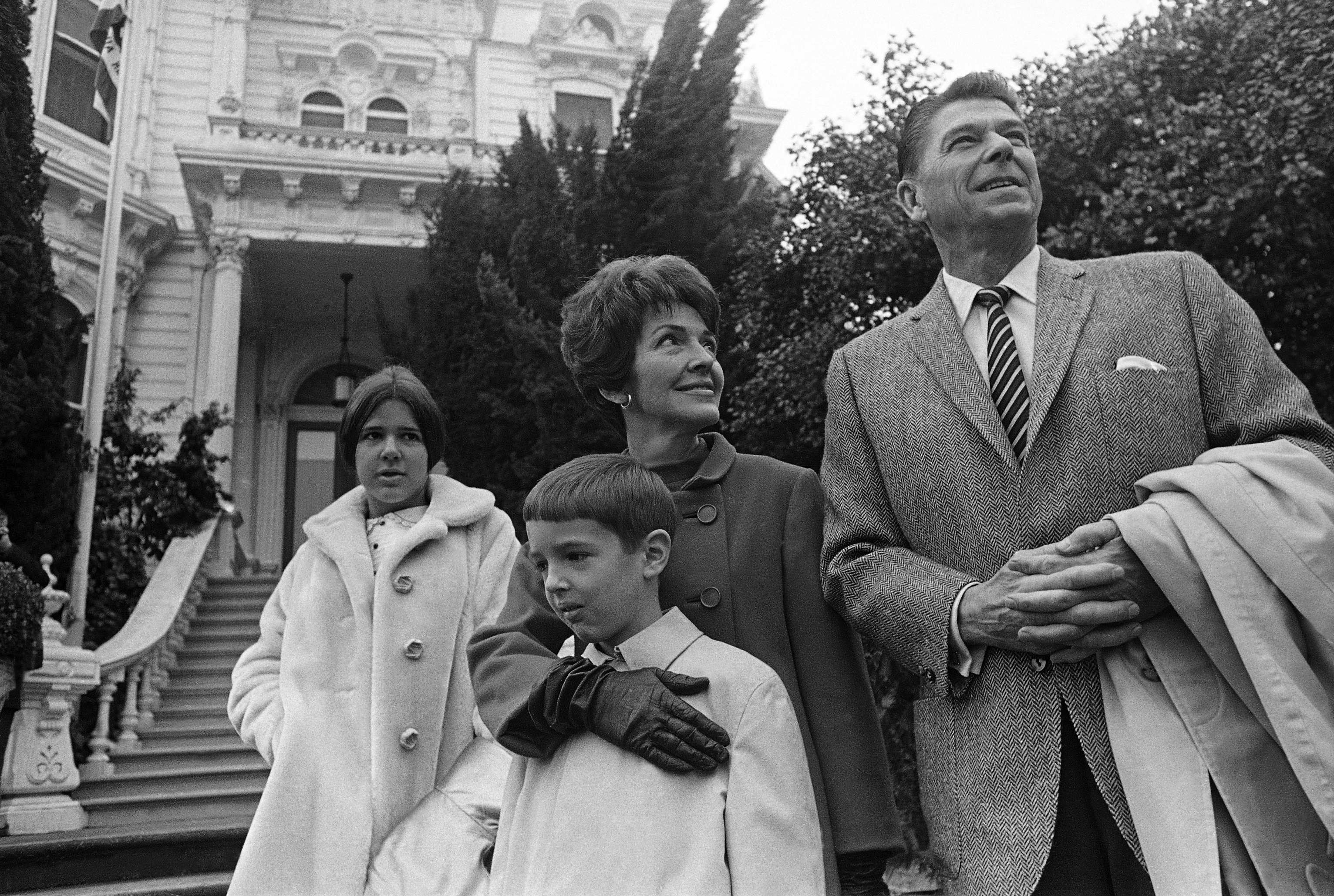Then governor-elect of California Ronald Reagan is photographer with his wife, Nancy, and children Ronald Jr., 8, and Patricia, 13, outside the Executive Mansion in Sacramento, Calif., on Jan. 1, 1967.