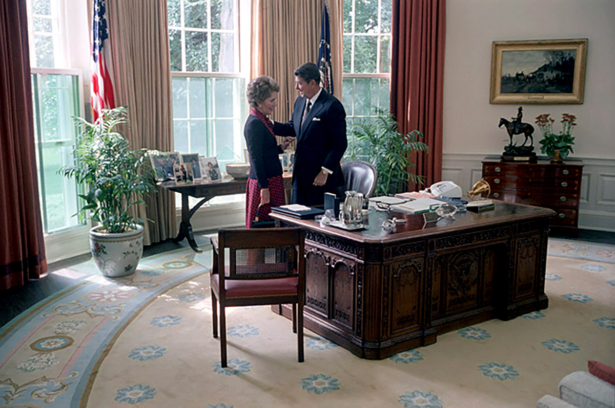 President Ronald Reagan and First Lady Nancy Reagan share a moment alone in the Oval Office on Sept. 16, 1981.