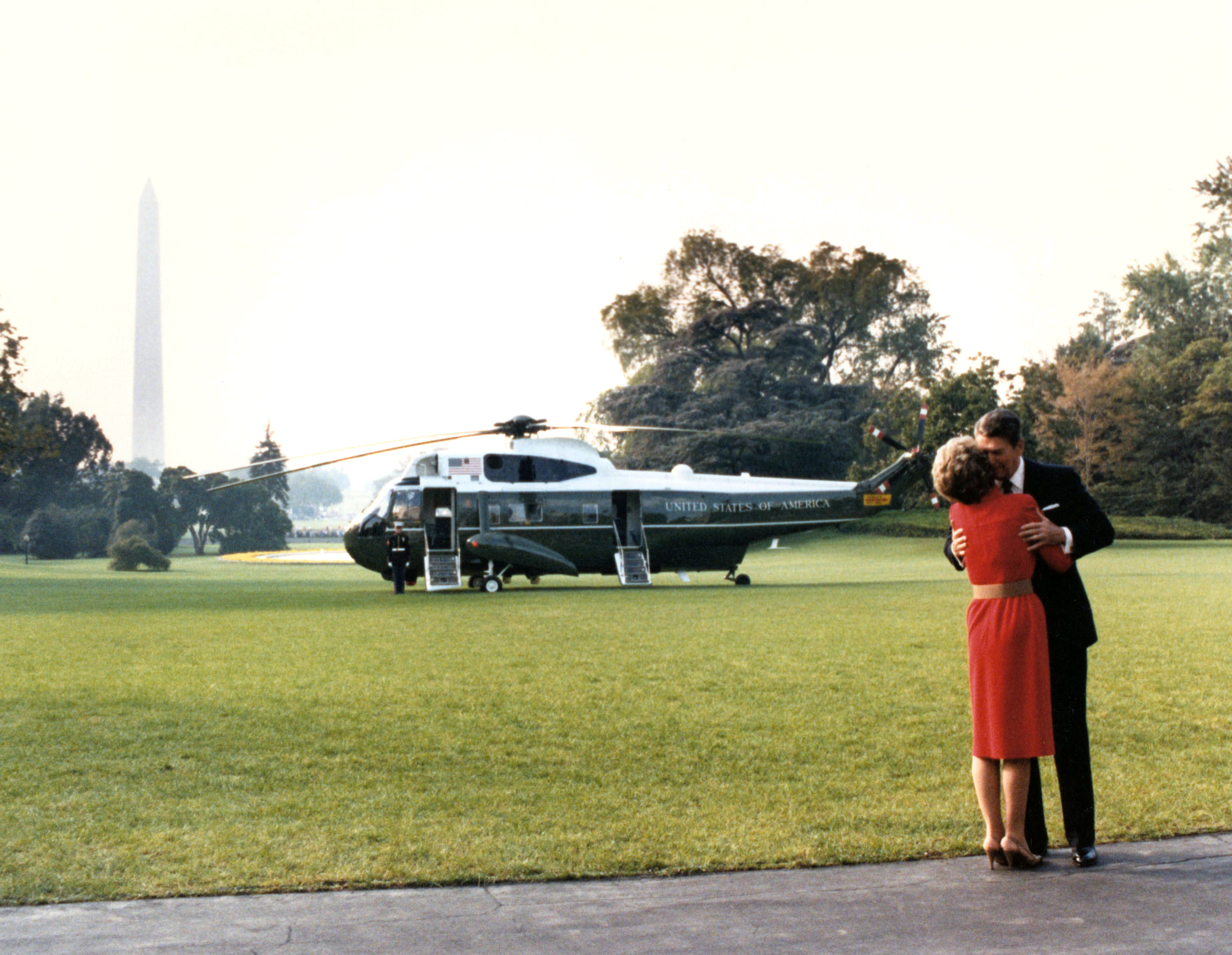 President Ronald Reagan kisses First Lady Nancy Reagan in Washington, in an undated photo.