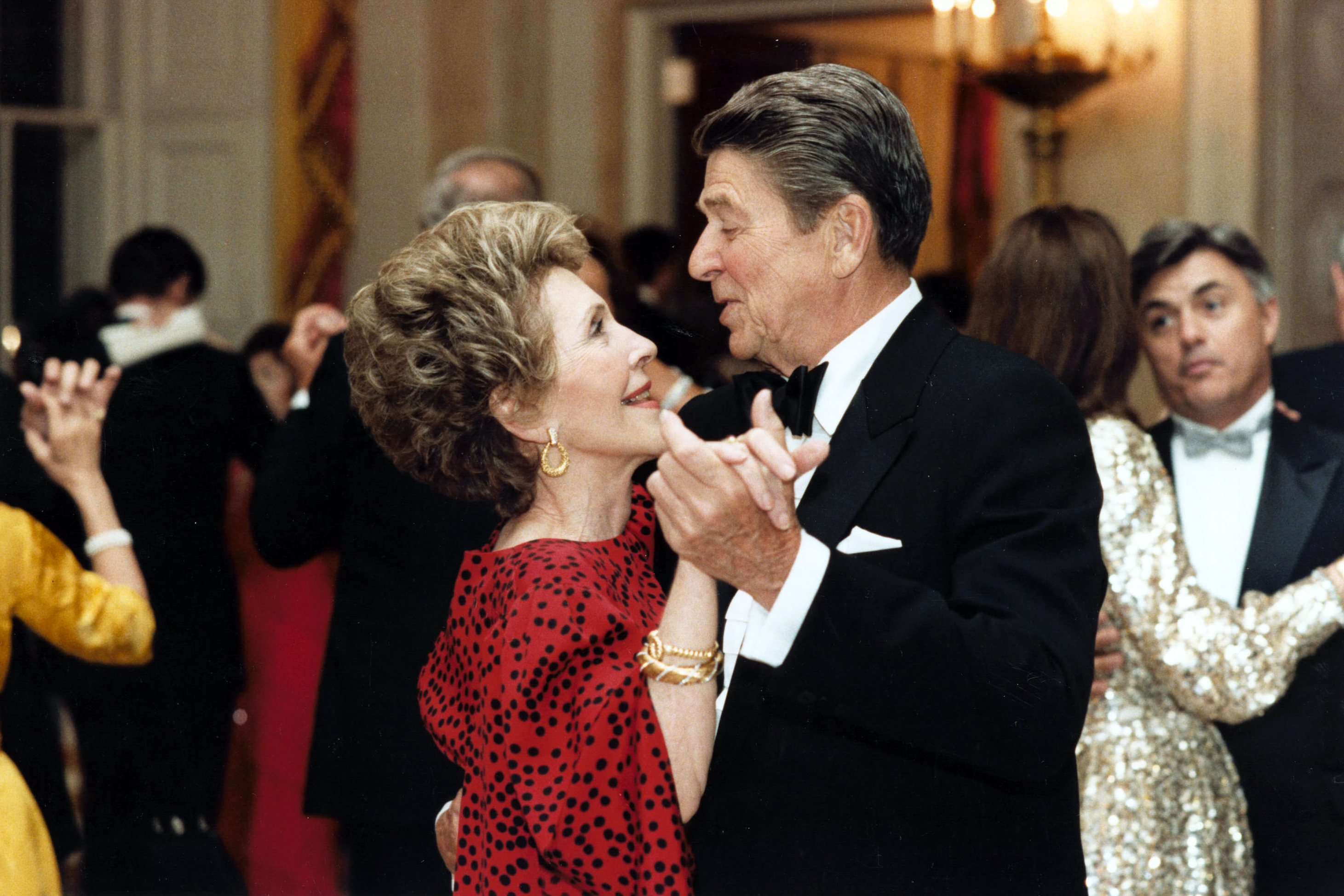 President Ronald Reagan dances with First Lady Nancy Reagan at the State Dinner for President Bendjedid of Algeria on April 17, 1985.