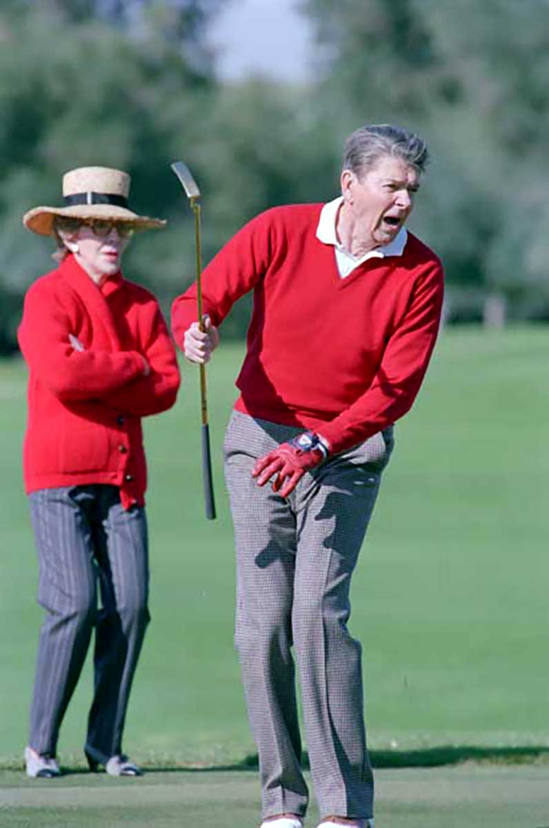 President Ronald Reagan plays golf as wife Nancy Reagan watches at Sunnylands Annenberg Estate in Rancho Mirage, Calif. on Dec. 31, 1988.