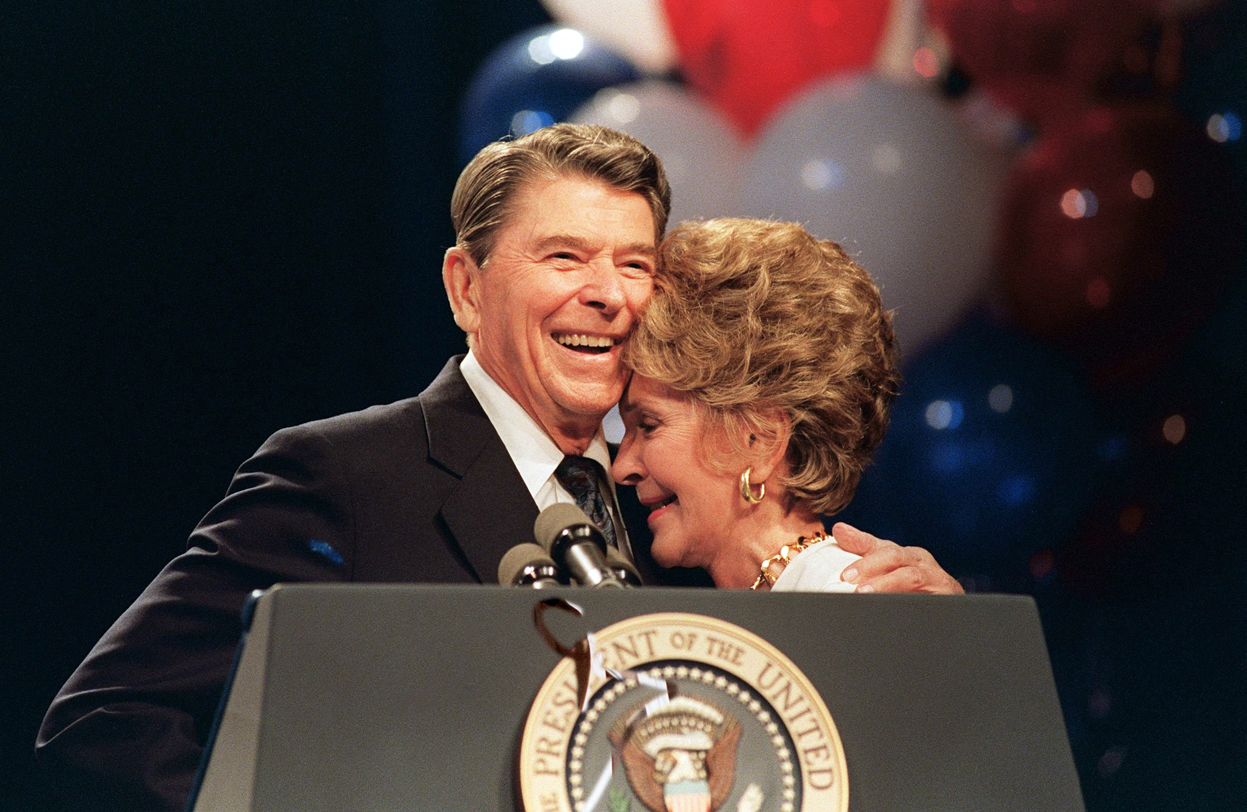 First Lady Nancy Reagan and her husband President Ronald Reagan appear during a luncheon in New Orleans on Aug. 15, 1988.