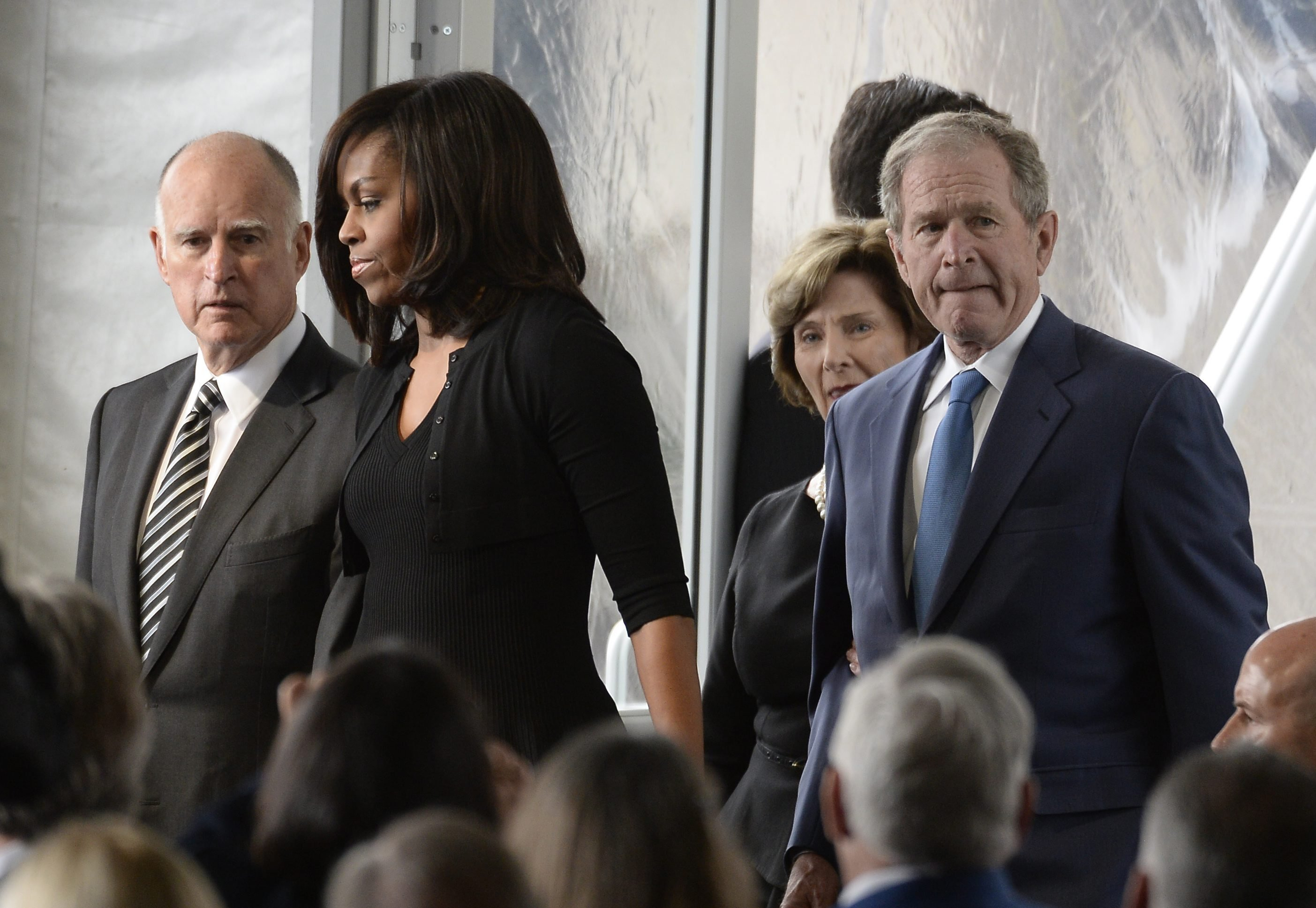 From left, California Governor Jerry Brown, First Lady Michelle Obama, former First Lady Laura Bush, and former President George Bush attend the funeral, March 11, 2016.