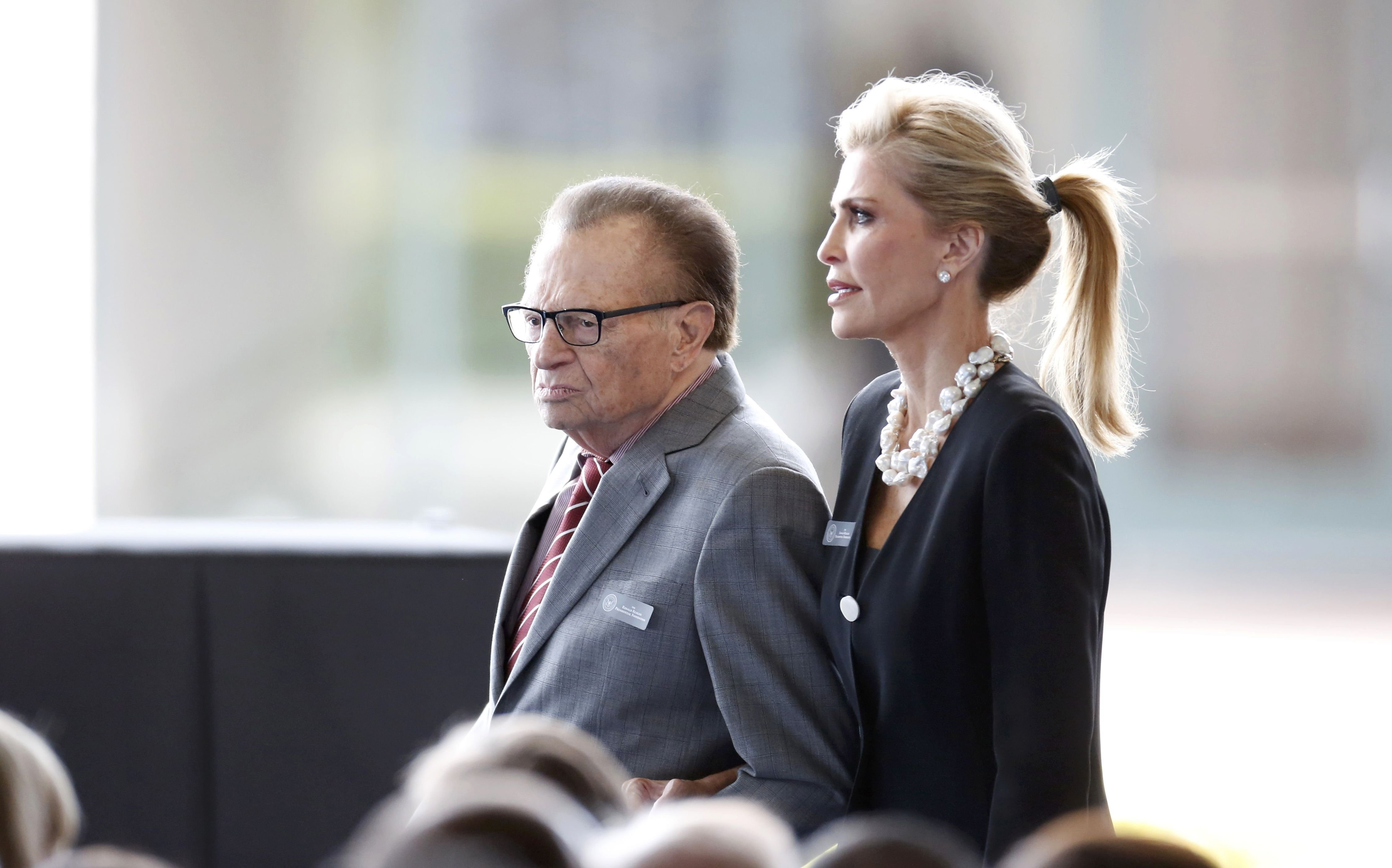 Television personality Larry King and his wife Shawn arrive for the funeral, March 11, 2016.
