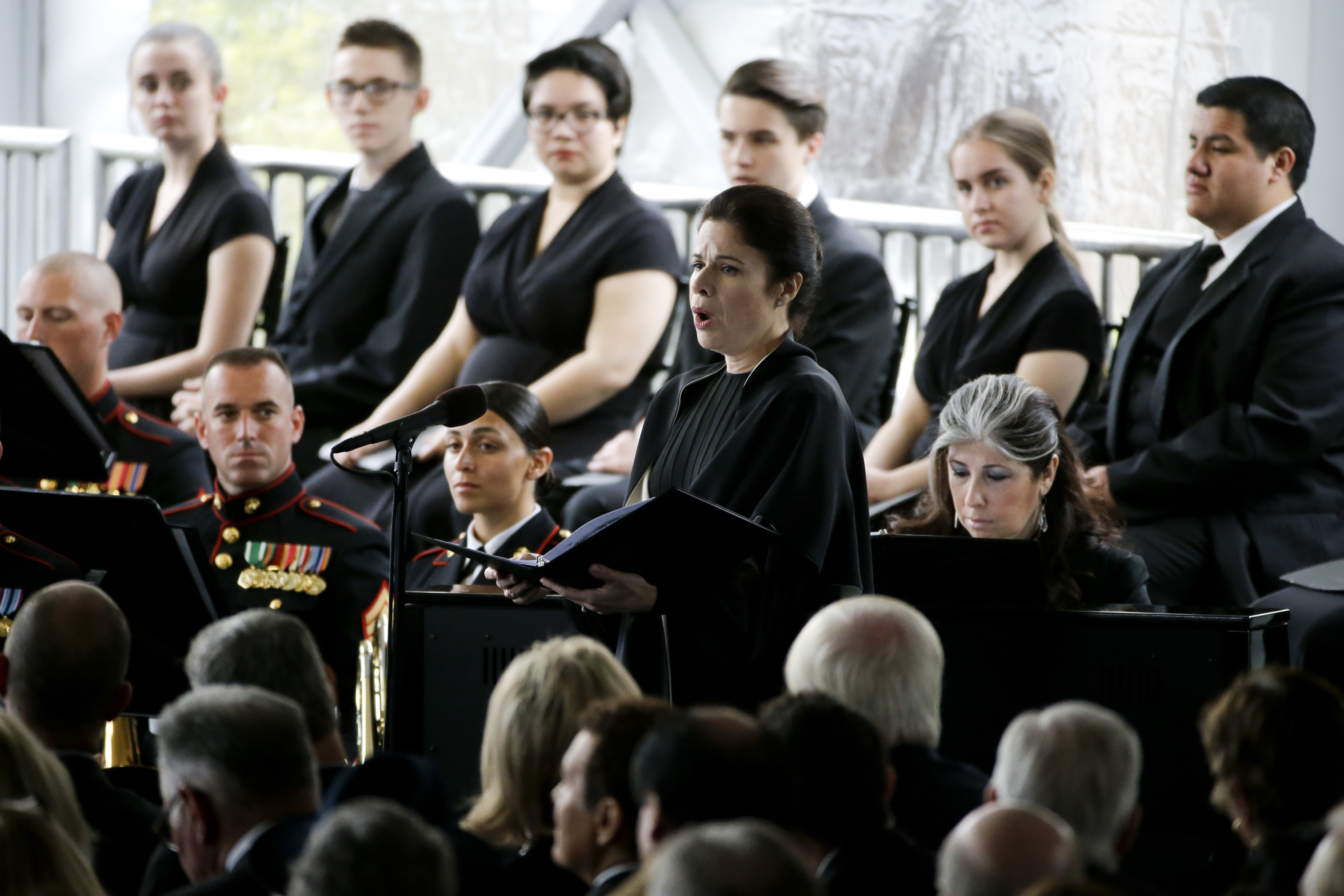 Opera singer Ana Maria Martinez sings Ave Maria during the funeral service.