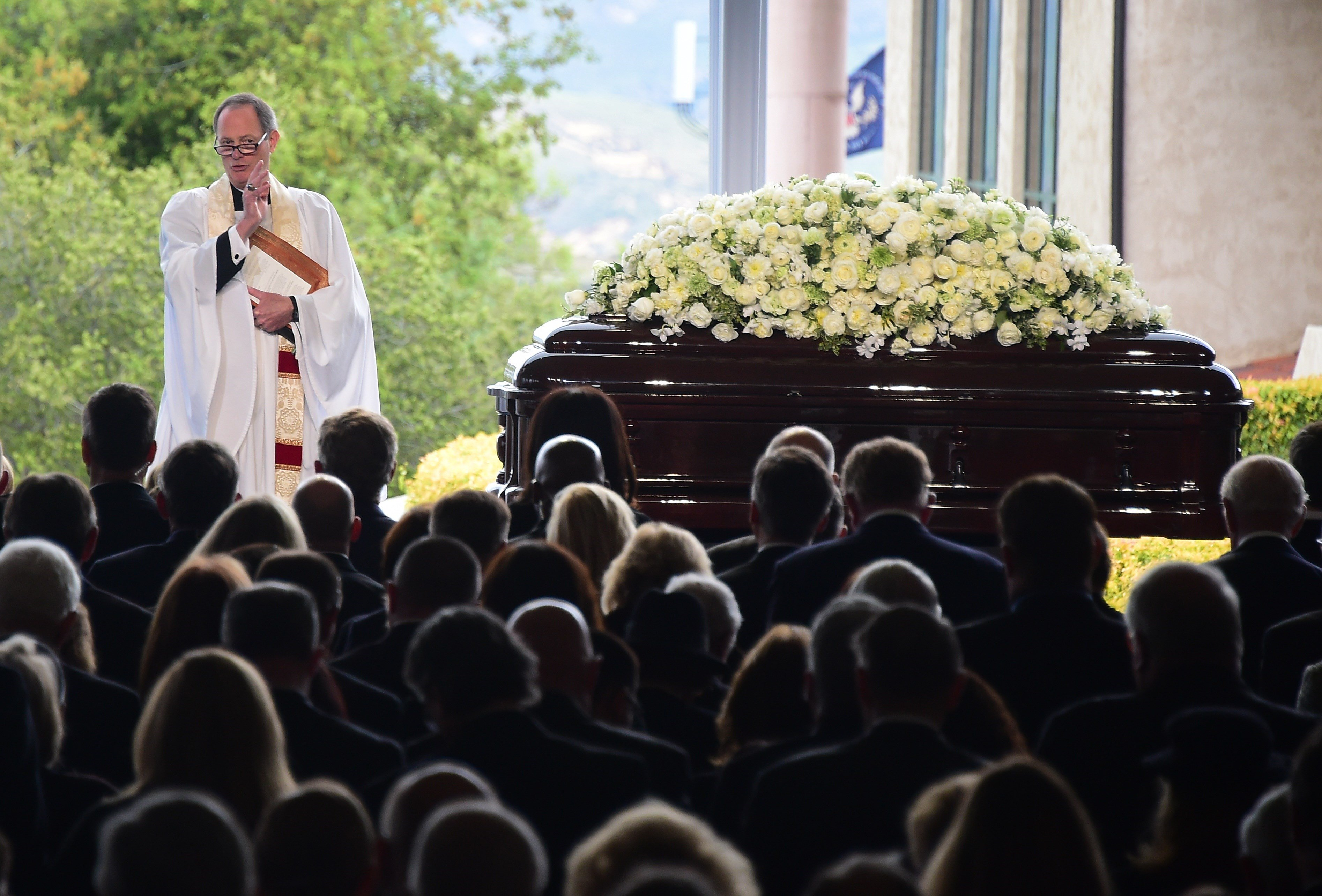 Reverend Stuart Kenworthy blesses the audience during the funeral service, March 11, 2016.