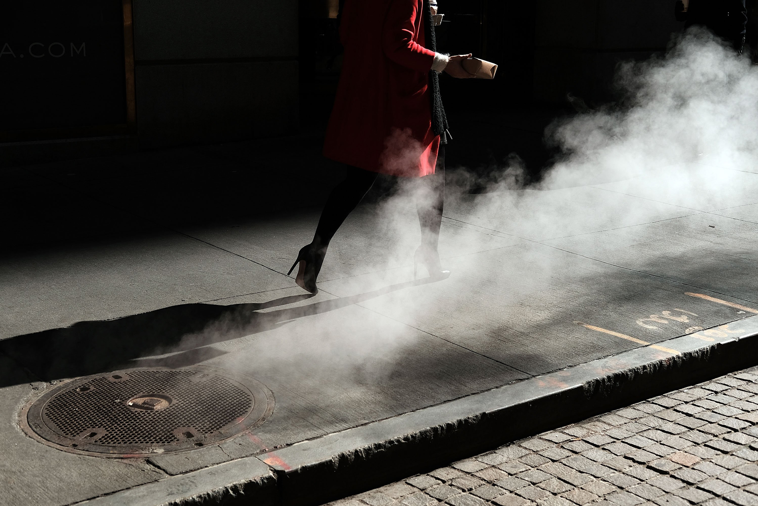 A woman walks by the New York Stock Exchange near Wall Street, in New York City, on March 21, 2016.