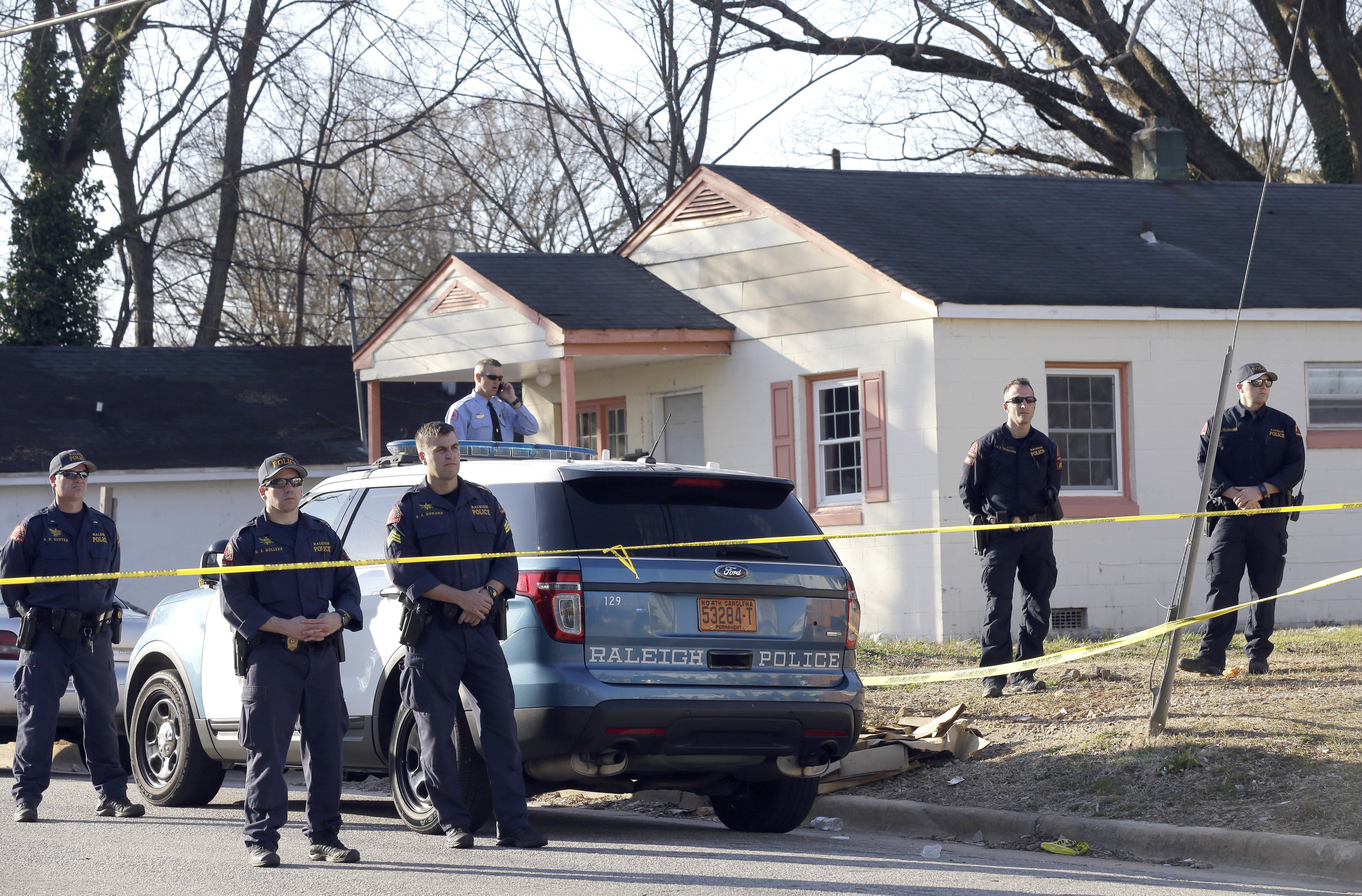 Police gather near the scene of a fatal shooting in Raleigh, NC on Feb. 29, 2016.