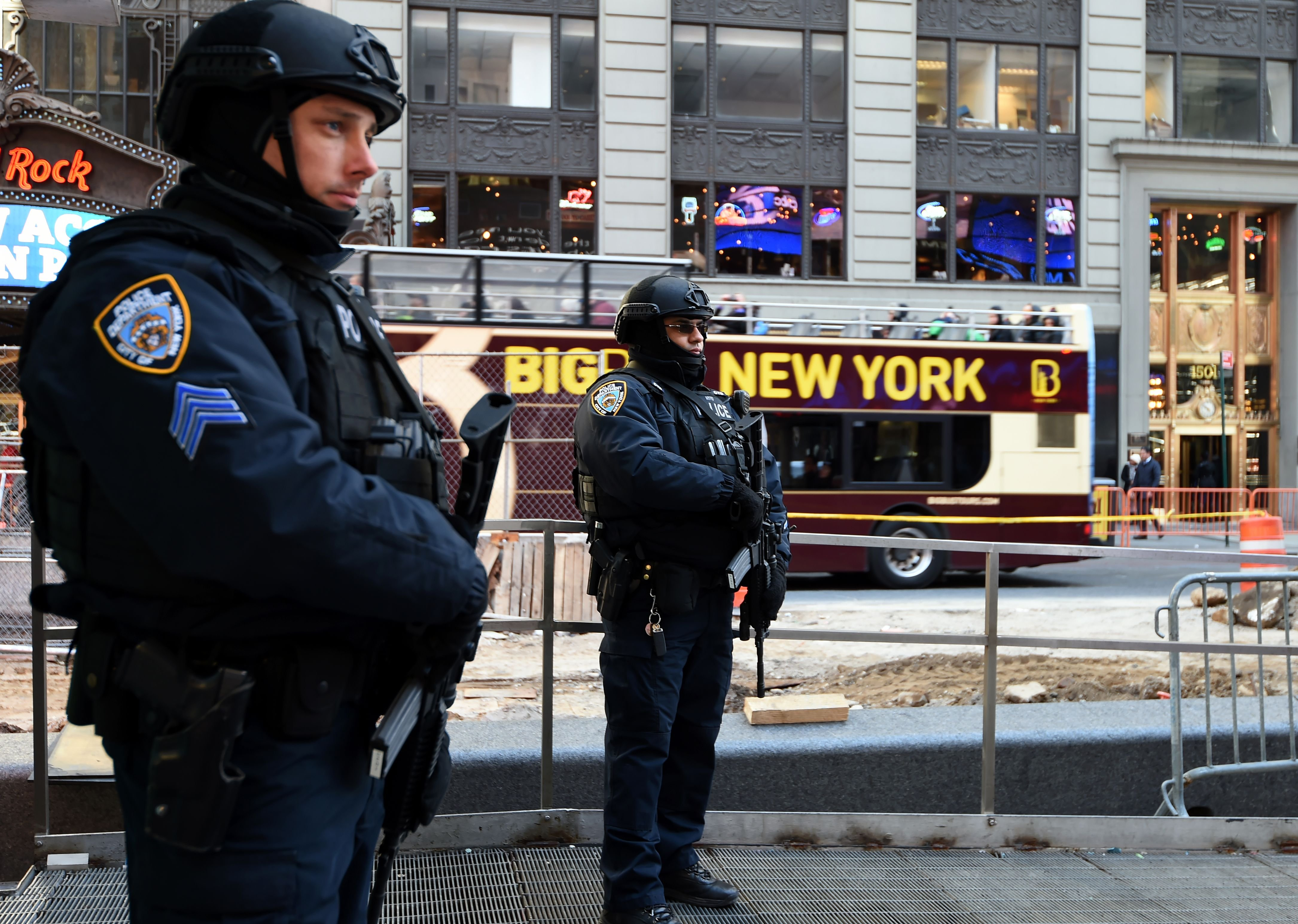 NYPD officers stand guard in Times Square, New York City, on March 22, 2016.
