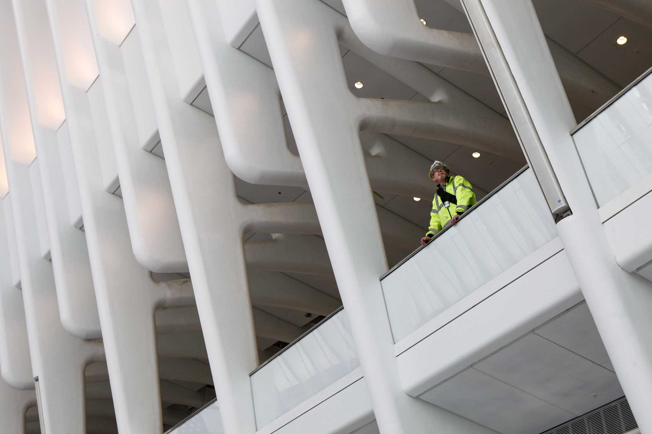 A worker watches people below.