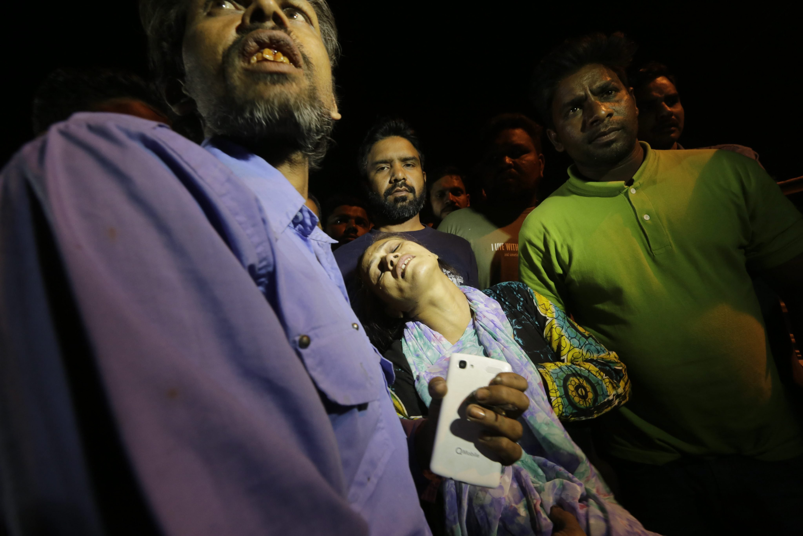 Relatives of the victims of a suicide bomb blast cry outside a hospital in Lahore, Pakistan, on March 27, 2016.