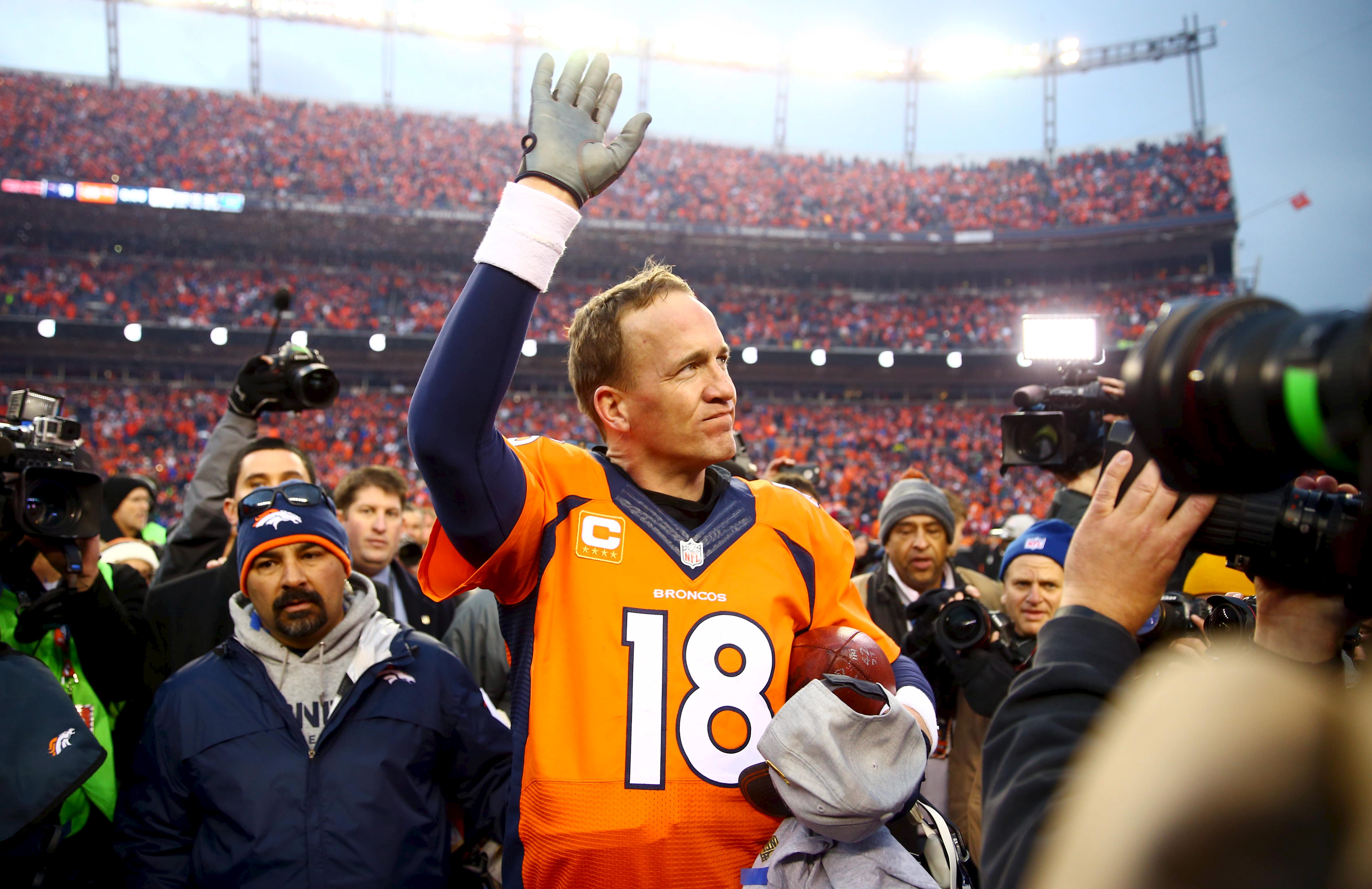 Denver Broncos quarterback Peyton Manning waves to the crowd after the AFC Championship football game against the New England Patriots at Sports Authority Field at Mile High in Denver, CO on Jan 24, 2016.