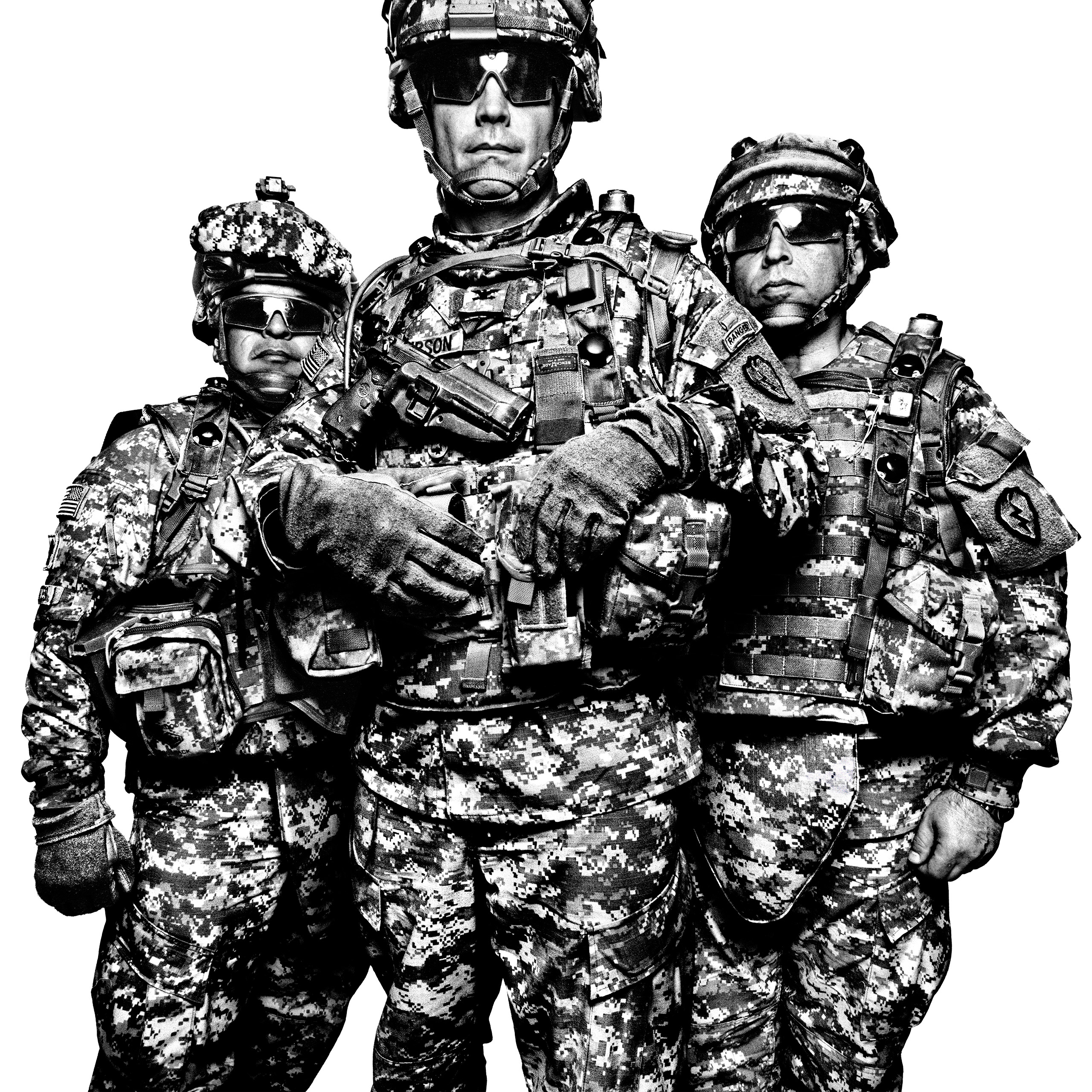 Command Sgt. Maj. Gabriel Cervantes (left) and Col. Burt Thompson (center) of the First Stryker                               Brigade Combat Team, with Interpreter John Mardo (right). There are thirteen                               enlisted ranks in the US Army, from private                               to sergeant major of the army. Officers range                               from second lieutenant to general of the                               army. Fort Irwin, 2008.