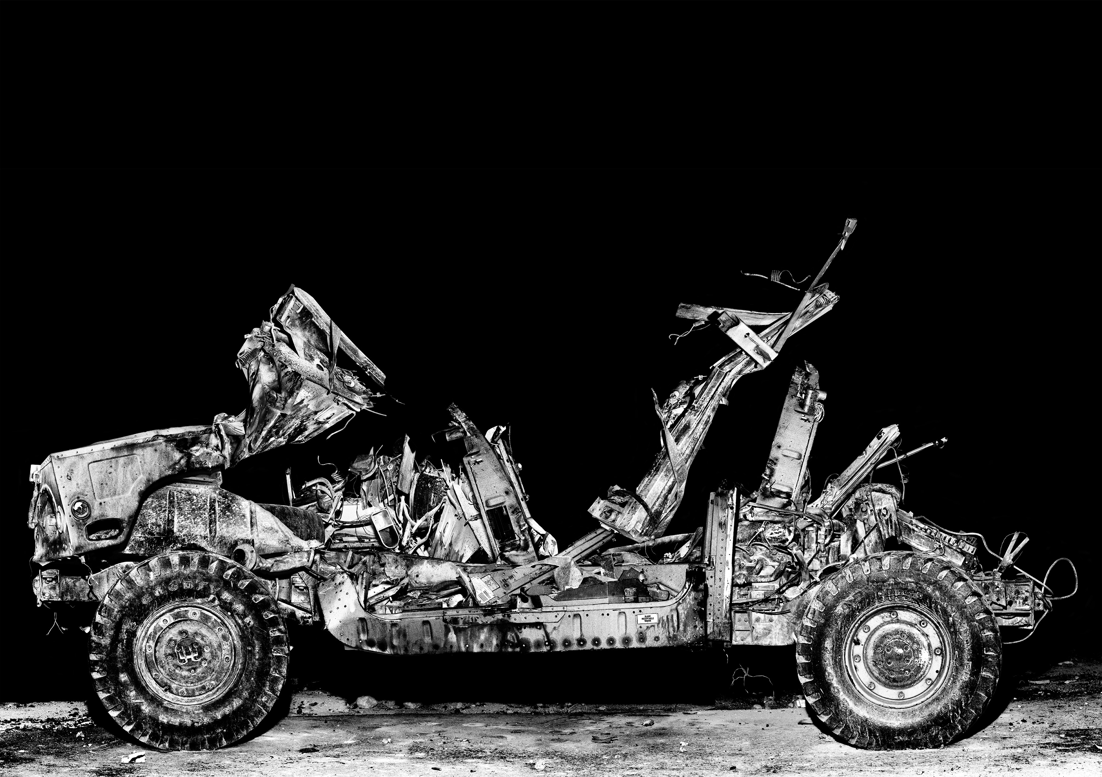 Using special effects, this Hummer                               explodes into flames multiple times a day in                               Medina Wasl, a mock Iraqi town at the NTC.                               Fort Irwin, 2008.