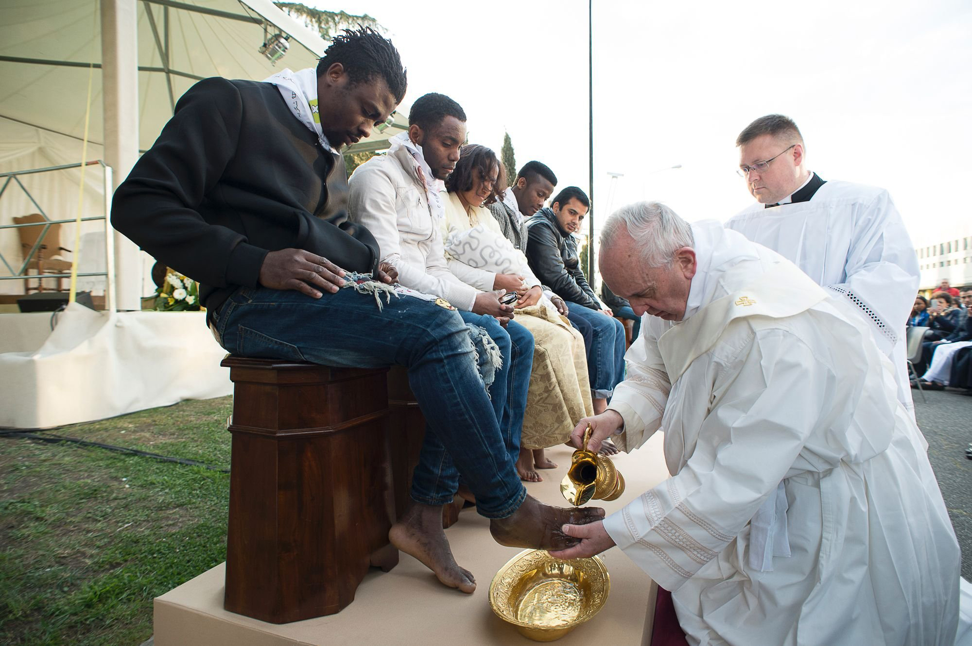 In this handout picture released by the Vatican Press Office, Pope Francis performs the foot-washing ritual at the Castelnuovo di Porto refugees center near Rome, Italy on March 24, 2016. Pope Francis washed the feet of 11 young asylum seekers and a worker at their reception centre to highlight the need for the international community to provide shelter to refugees.