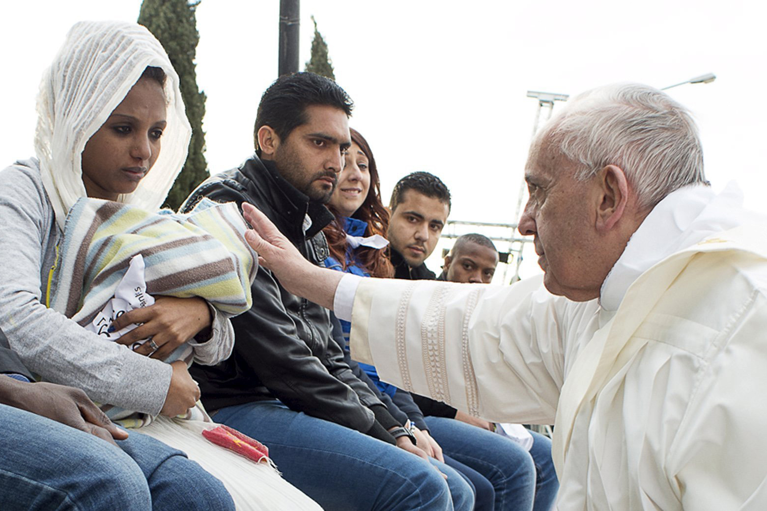 Pope Francis blesses a baby during the foot-washing ritual at the Castelnuovo di Porto refugees center near Rome, Italy, on March 24, 2016.