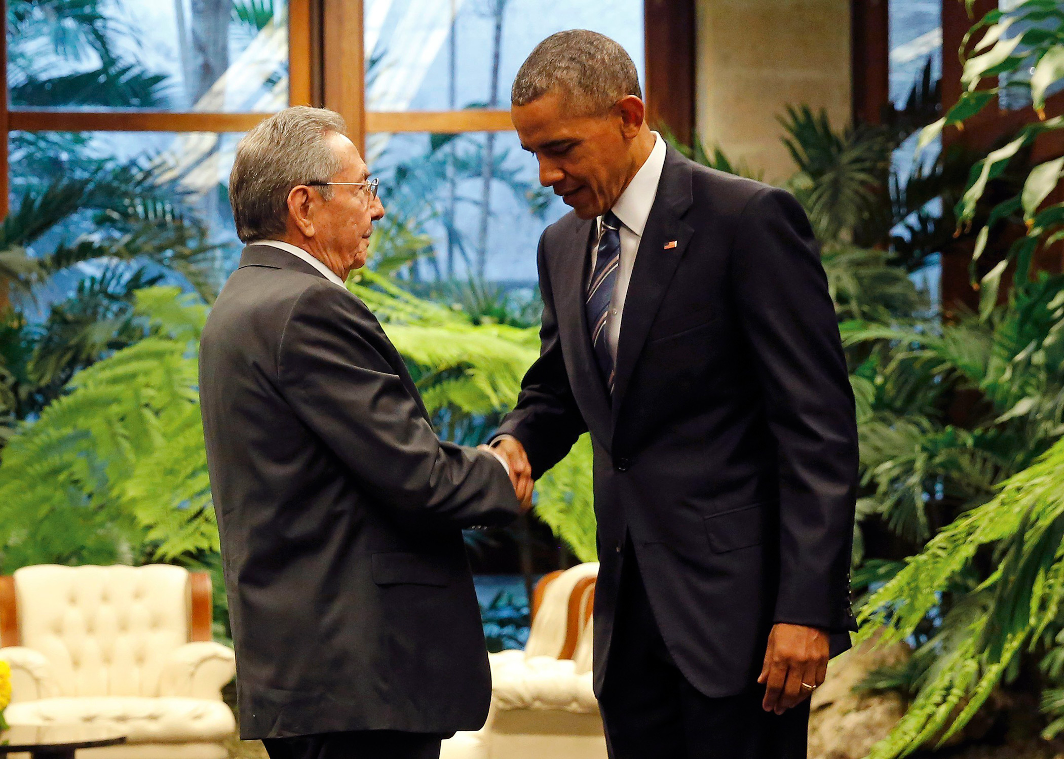 President Barack Obama and Cuba's President Raul Castro shake hands during the U.S. President's historic trip to Cuba – the first by a sitting president in 88 years - on March 21, 2016.  The meeting, held in Havana, will pave the way for closer economic ties between the two countries, more than 50 years after Cuba's revolution.