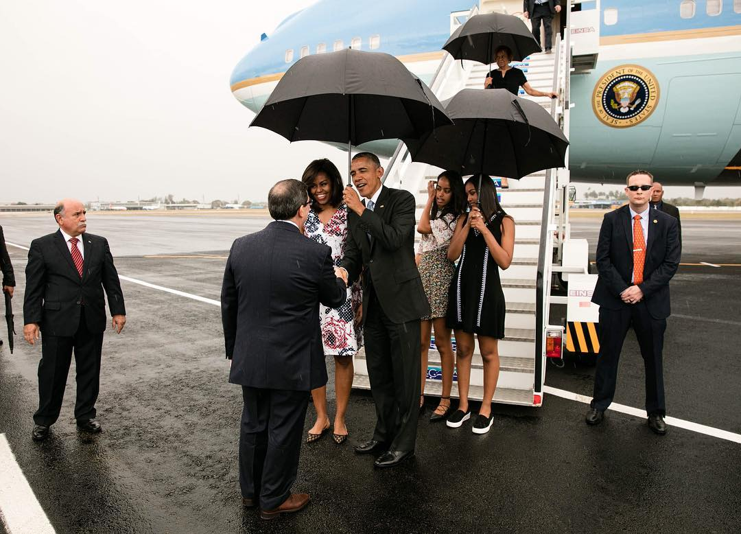 In this photo released by the White House, President Barack Obama, First Lady Michelle Obama, and daughters Malia and Sasha greet dignitaries upon arrival in Havana on March 20, 2016.