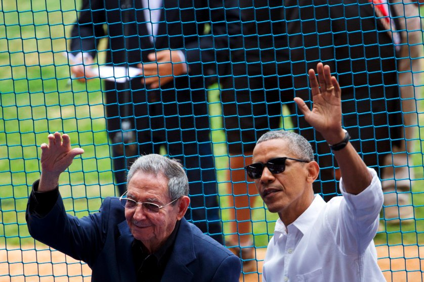 U.S. President Barack Obama, right, and Cuban President Raul Castro wave to fans as they arrive for a baseball game between the Tampa Bay Rays and the Cuban national baseball team in Havana on Tuesday, March 22, 2016.