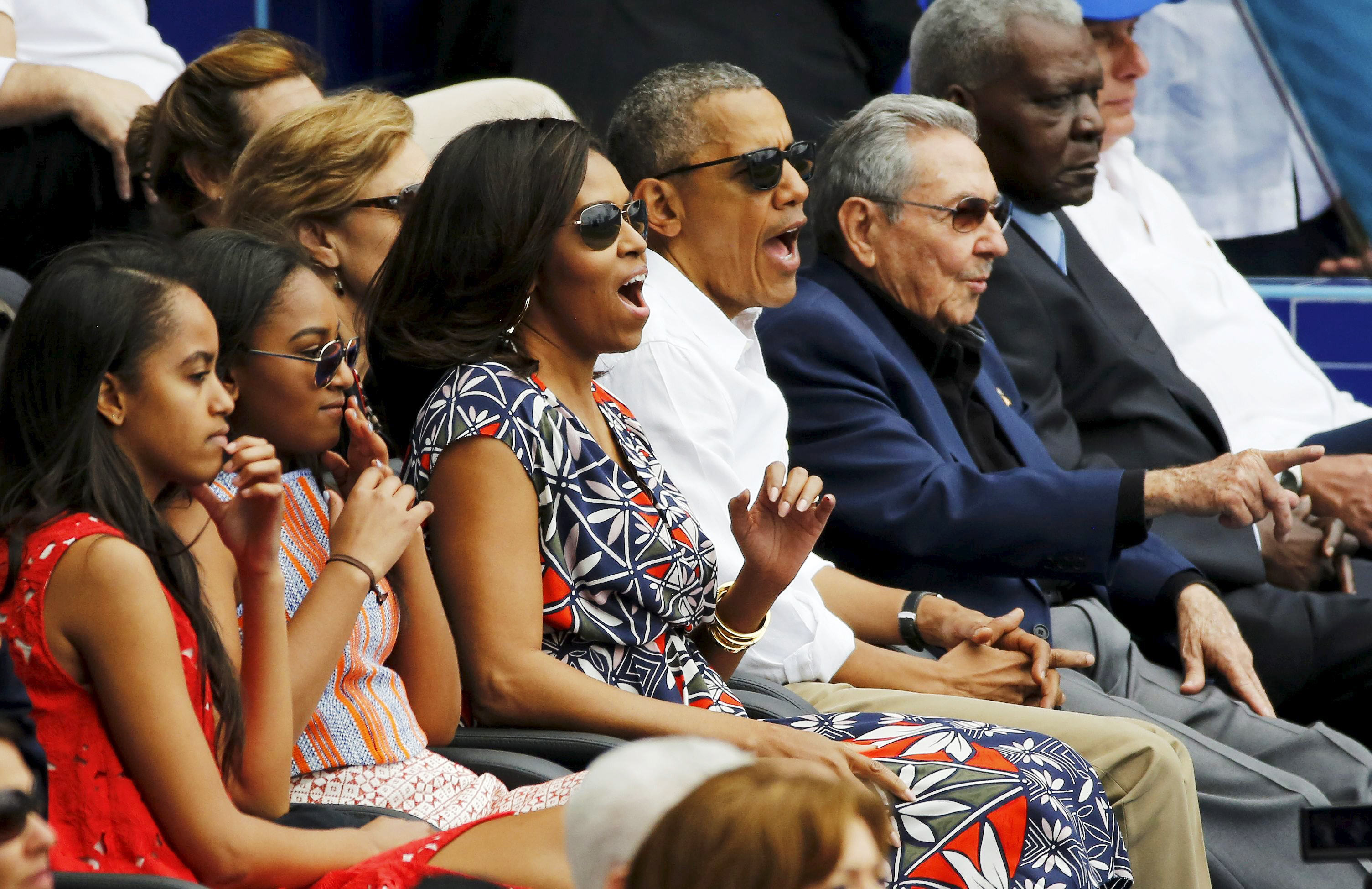 President Obama and his family watch a baseball game with Cuban President Castro in Havana on March 22.