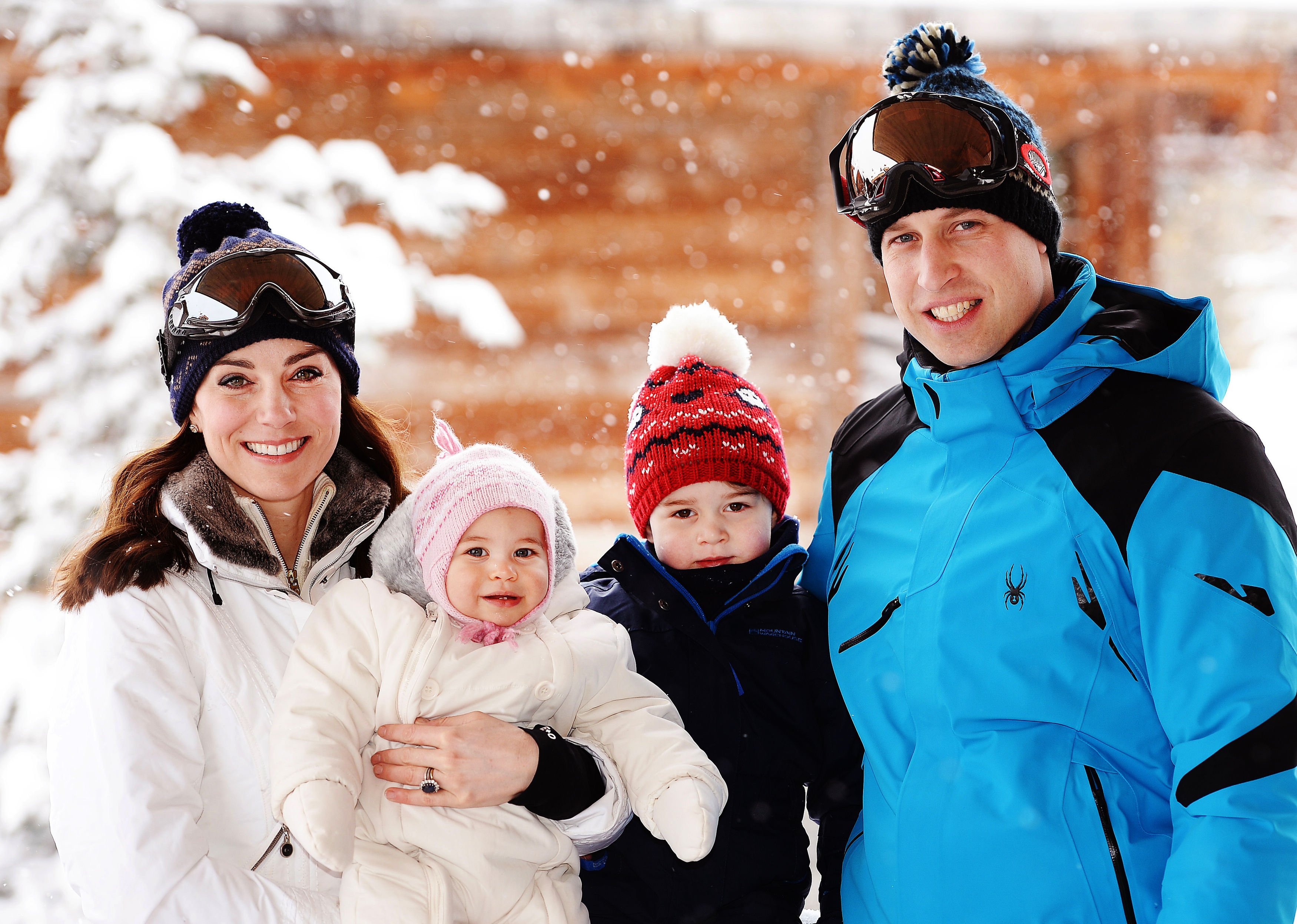 Britain's Catherine, Duchess of Cambridge and Prince William, Duke of Cambridge, pose with their children, Princess Charlotte and Prince George during a private break skiing in the French Alps on March 3, 2016.