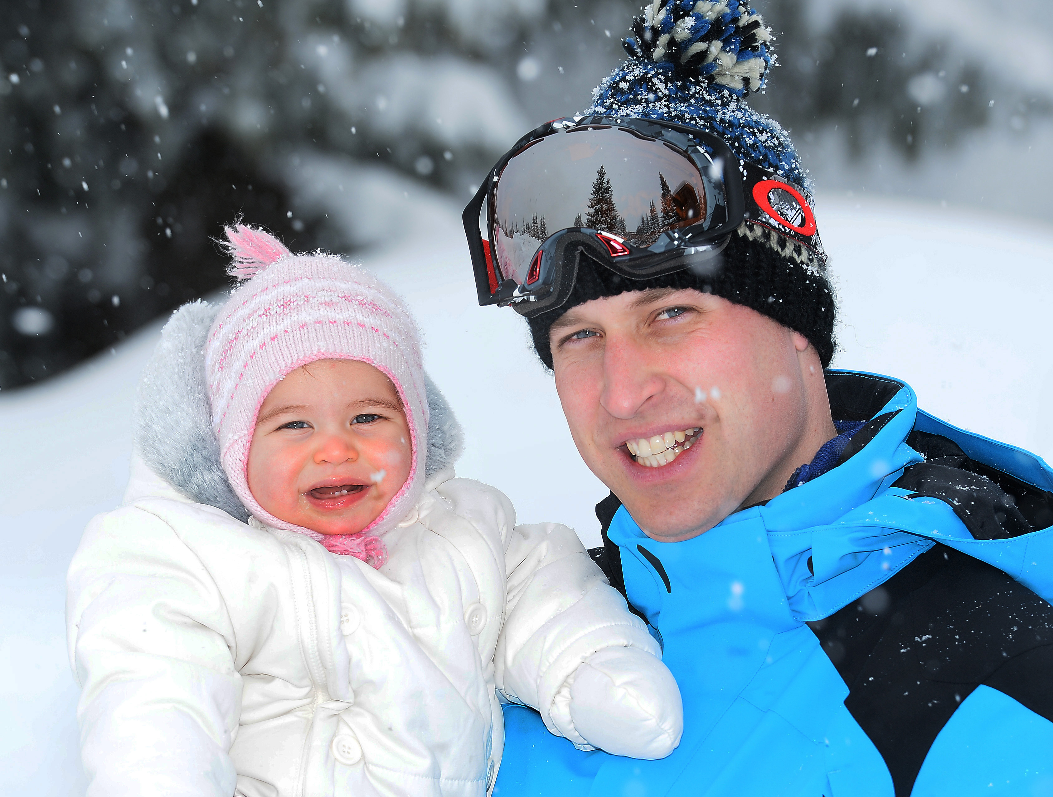 Britain's Prince William, Duke of Cambridge, poses with his daughter, Princess Charlotte during a private break skiing in the French Alps on March 3, 2016.