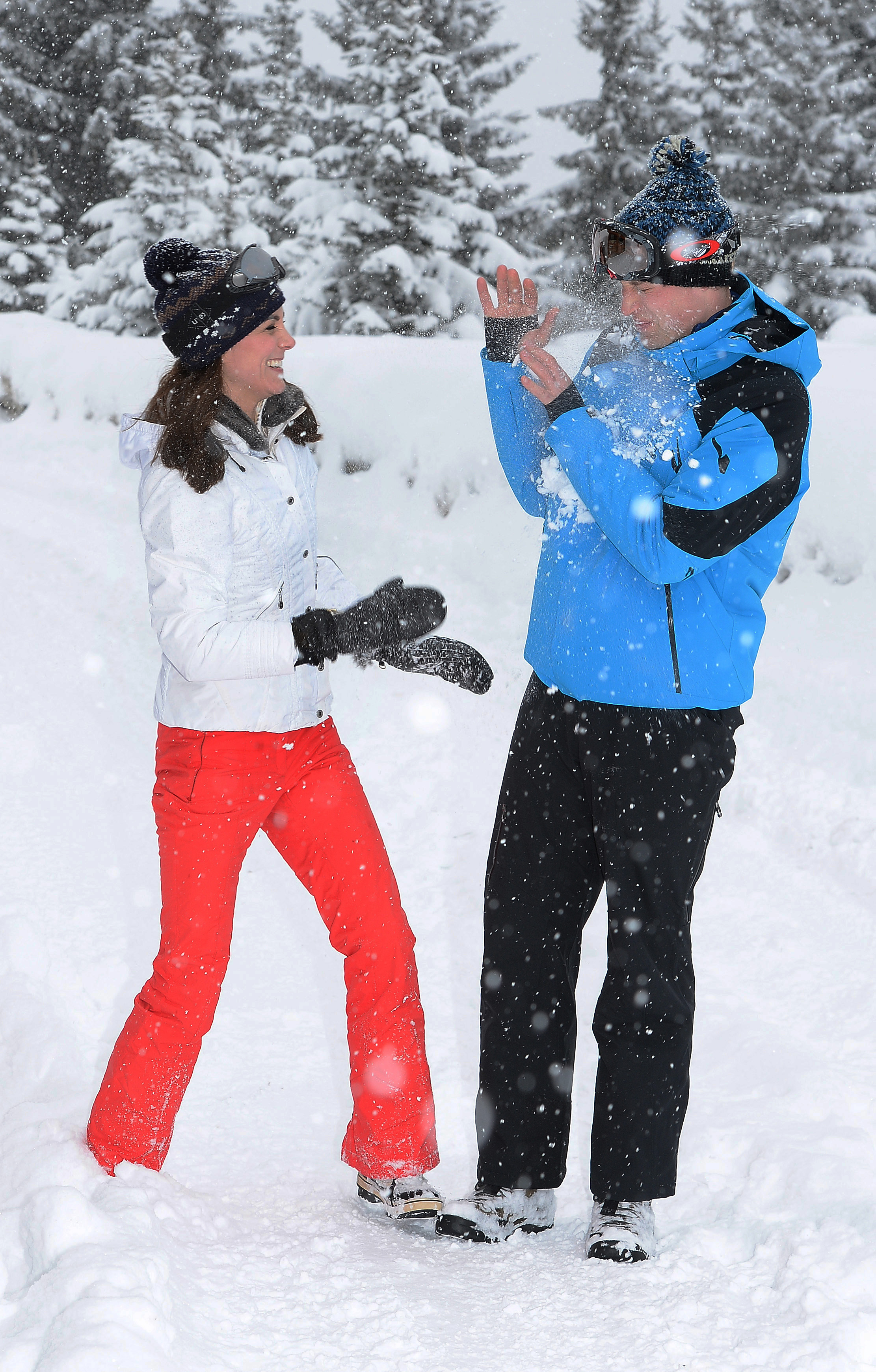 Britain's Catherine, Duchess of Cambridge and Prince William, Duke of Cambridge, have a snowball fight while skiing in the French Alps on March 3, 2016.