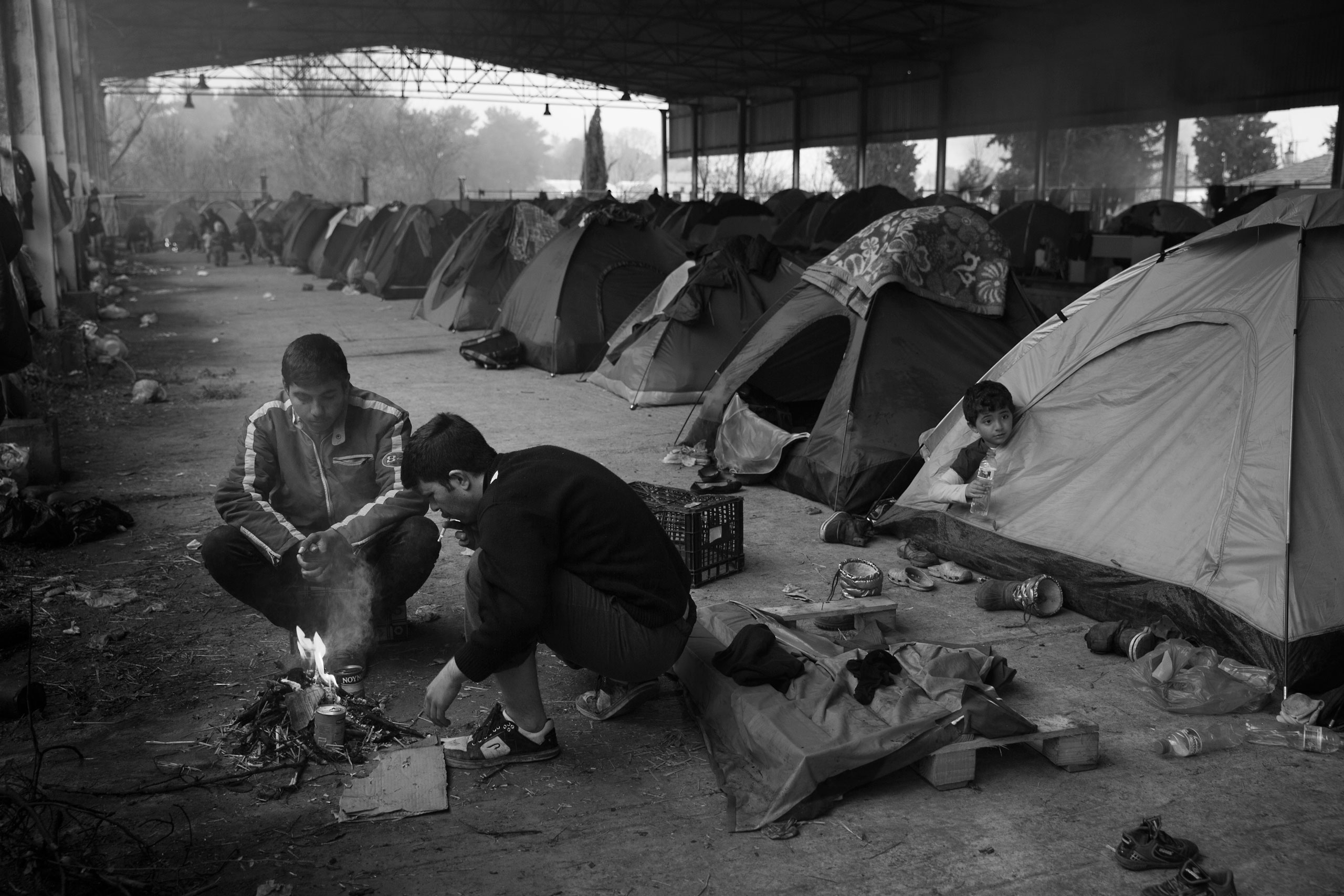 Tents line the inside of an old railway hangar near the town of Idomeni, Greece at the border with Macedonia. The refugees are being stopped from moving beyond Greece leaving thousands stranded in desperate conditions, March 13, 2016.