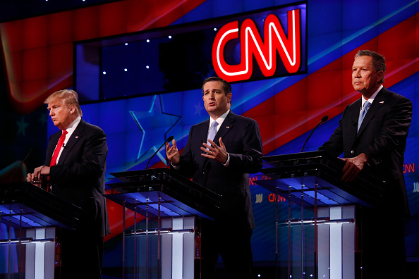 The four remaining Republican primary candidates Marco Rubio (not shown), Donald Trump, Ted Cruz, and John Kasich take part in a debate at the University of Miami on March 10, 2016, hosted by CNN and the Washington Times.