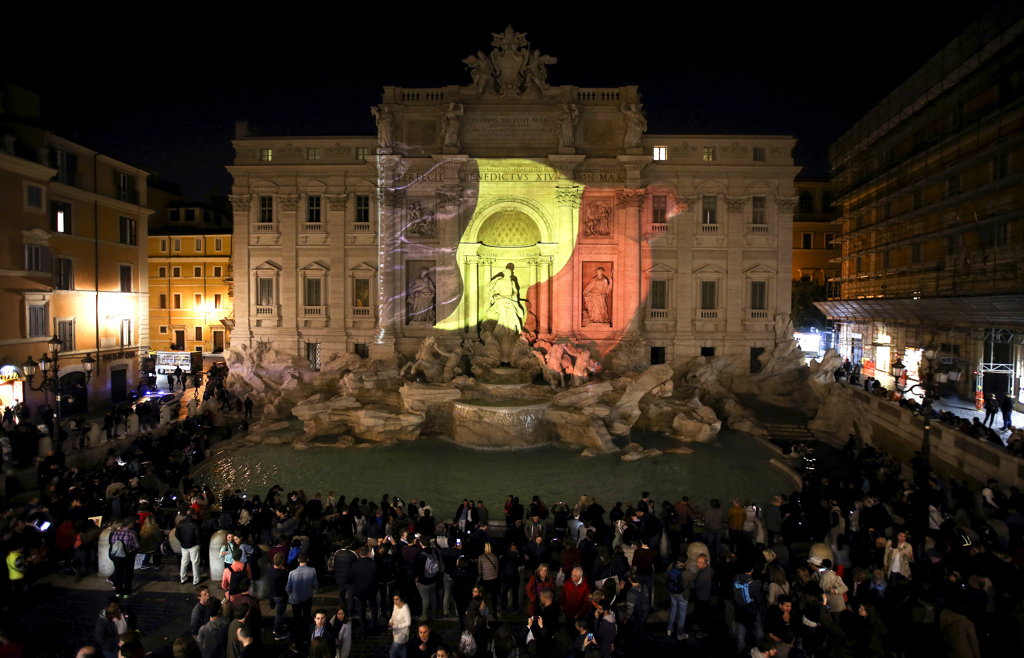 The black, yellow, and red colors of the Belgian flag are projected on the Trevi fountain in Rome, Italy, in tribute to the victims of today's Brussels bomb attacks March 22, 2016.