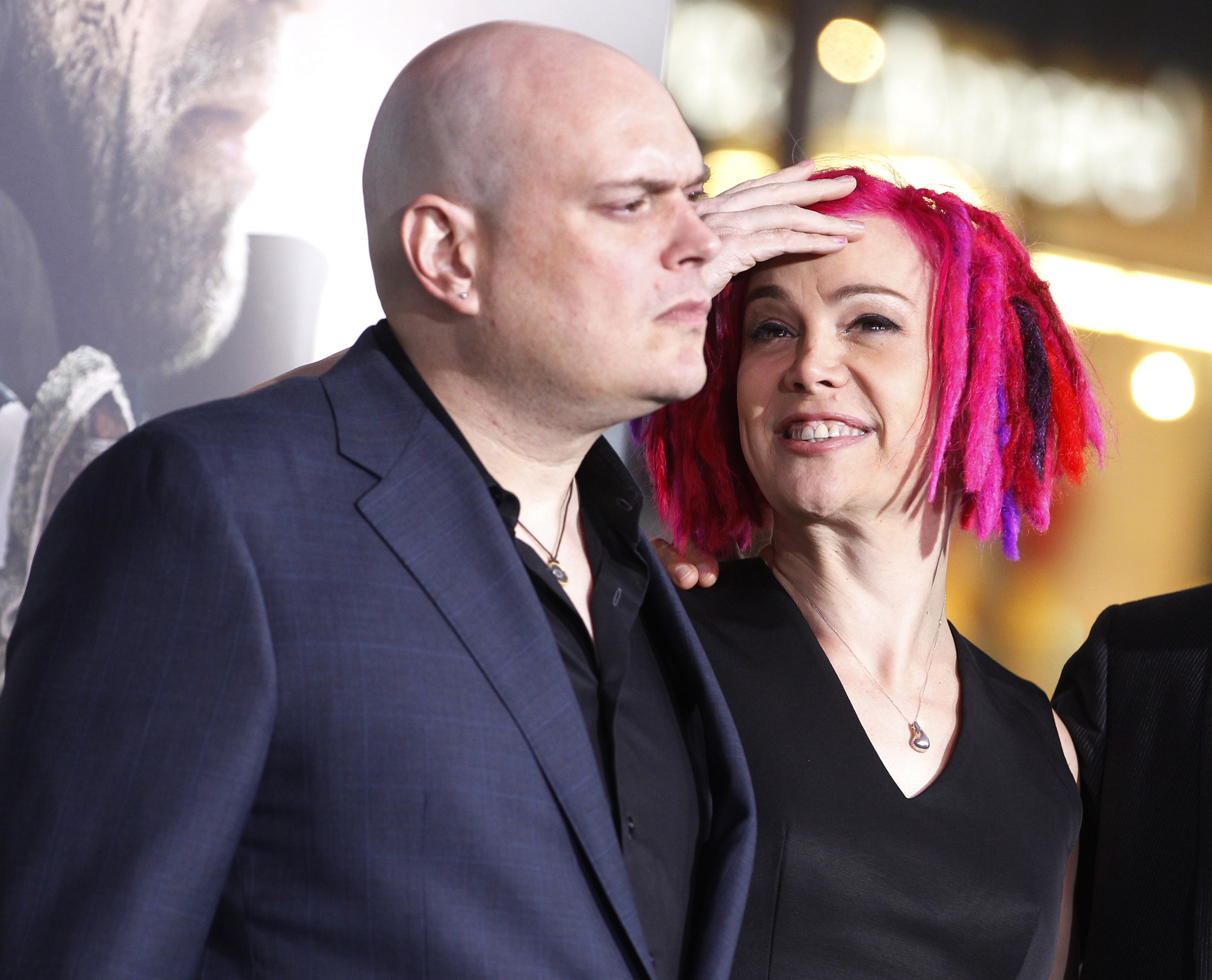 Lilly Wachowski prior to her transition, left, and sibling Lana Wachowski, the screenwriters, producers and directors of film Cloud Atlas, pose as they arrive for the film's premiere on Oct. 24, 2012