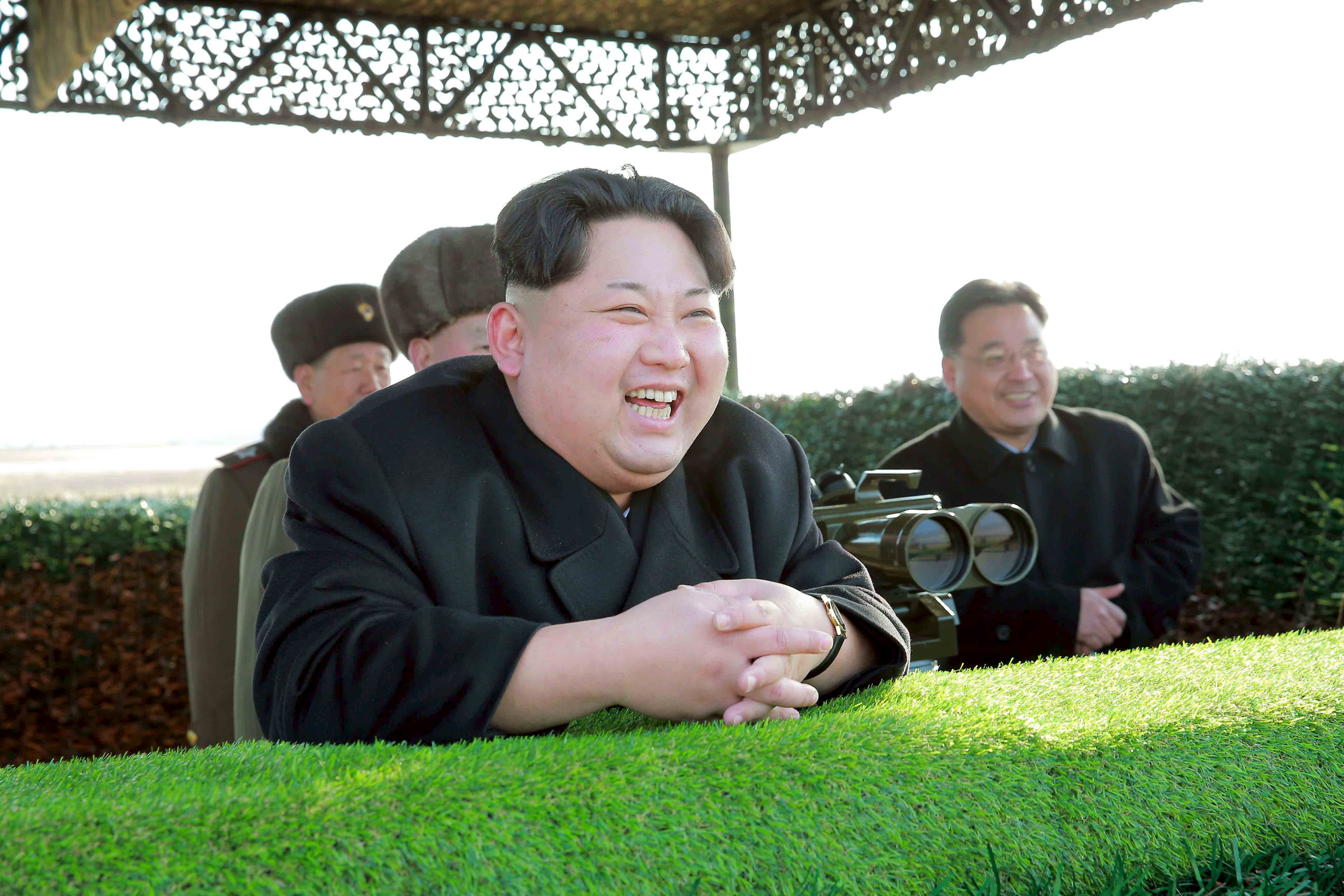 North Korean leader Kim Jong Un reacts during a test-fire of an anti-tank guided weapon in this undated photo released by North Korea's Korean Central News Agency (KCNA) in Pyongyang February 27, 2015.