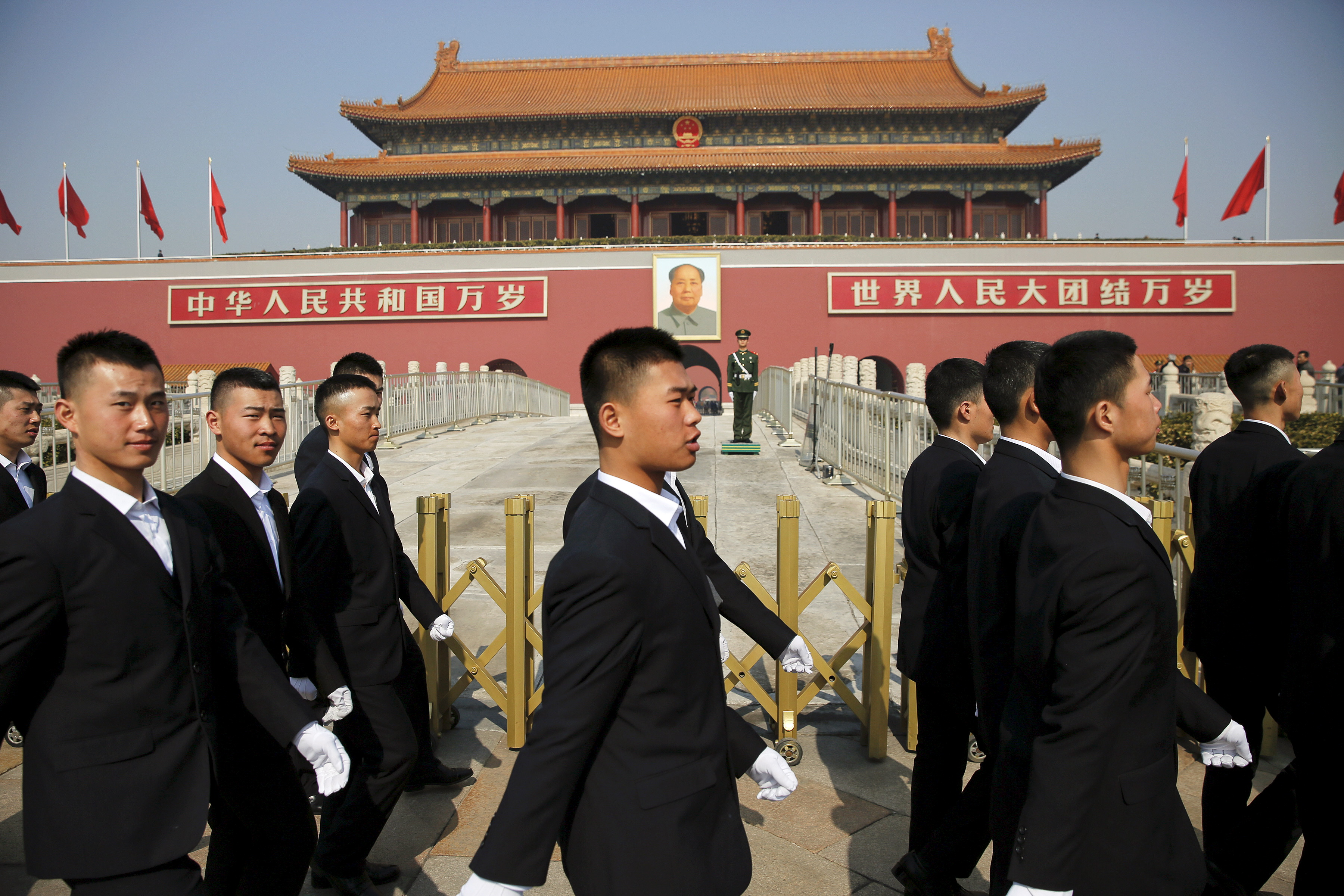 Security personnel march in front of Tiananmen Gate as the area near the Great Hall of the People prepares for upcoming annual sessions of the National People's Congress and Chinese People's Political Consultative Conference in Beijing on March 2, 2016