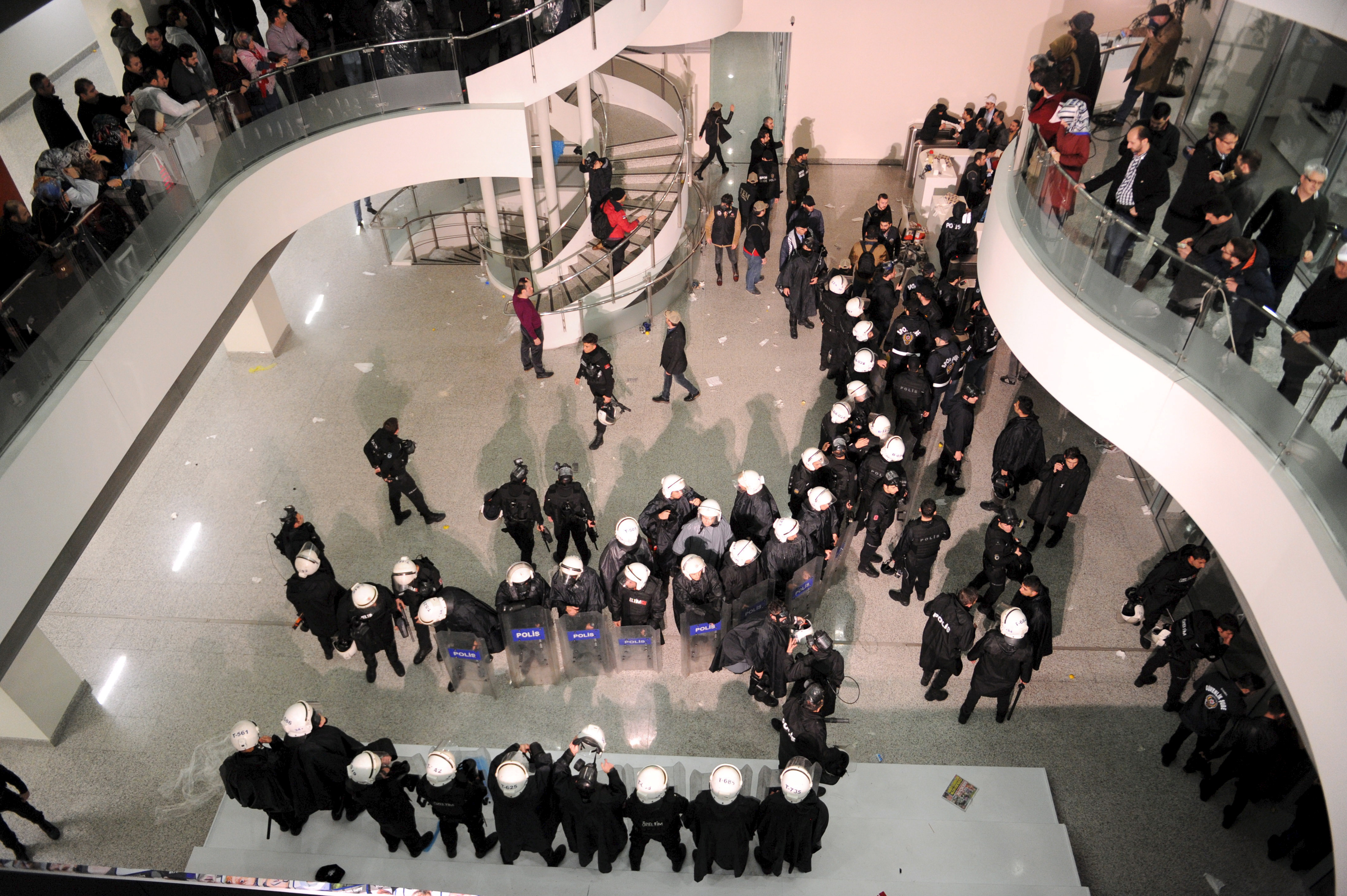 Riot police stand at the headquarters of Zaman newspaper in Istanbul, Turkey, late March 4, 2016