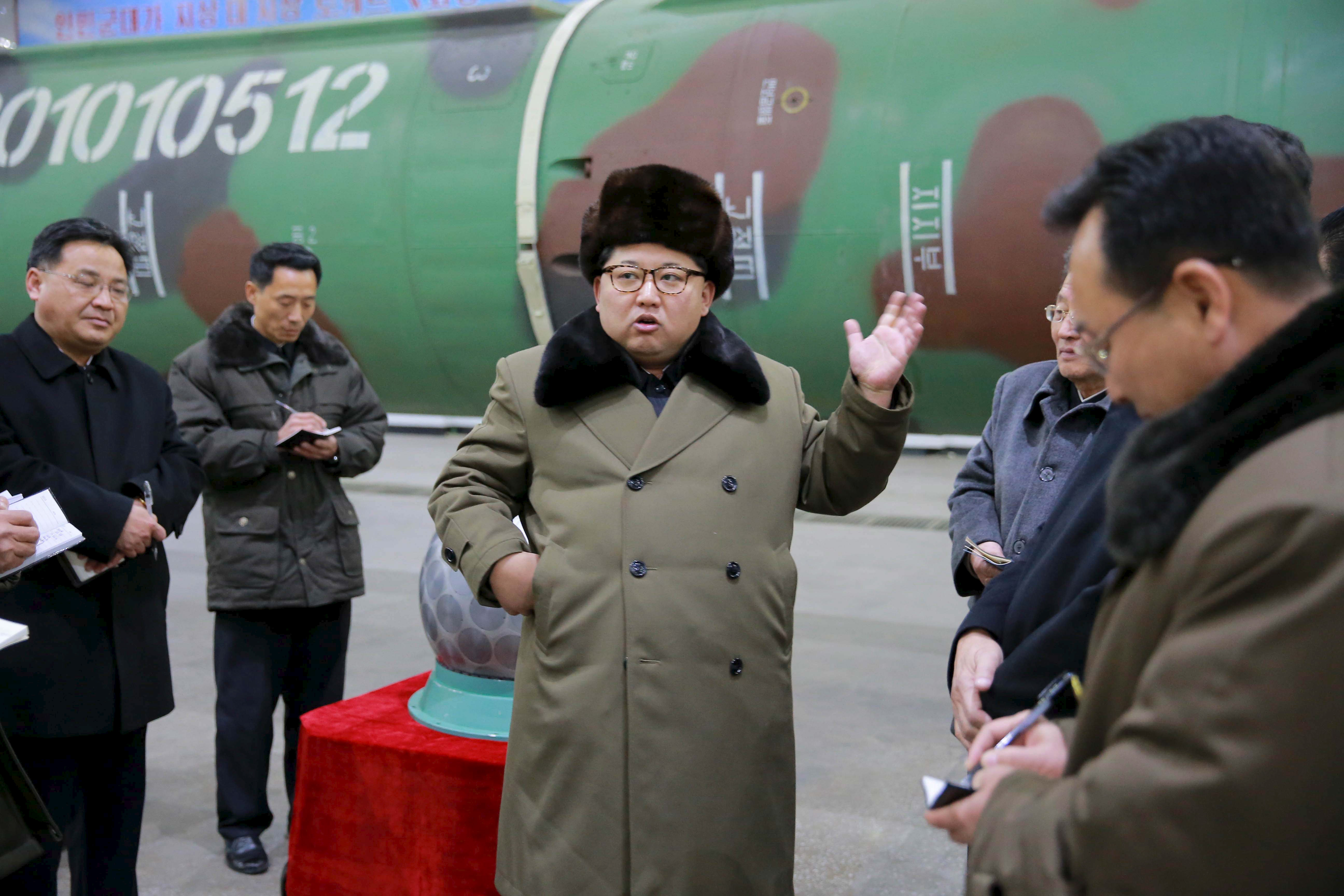 North Korean leader Kim Jong Un meets scientists and technicians in the field of research into nuclear weapons in this undated photo released by the country's Korean Central News Agency in Pyongyang on March 9, 2016