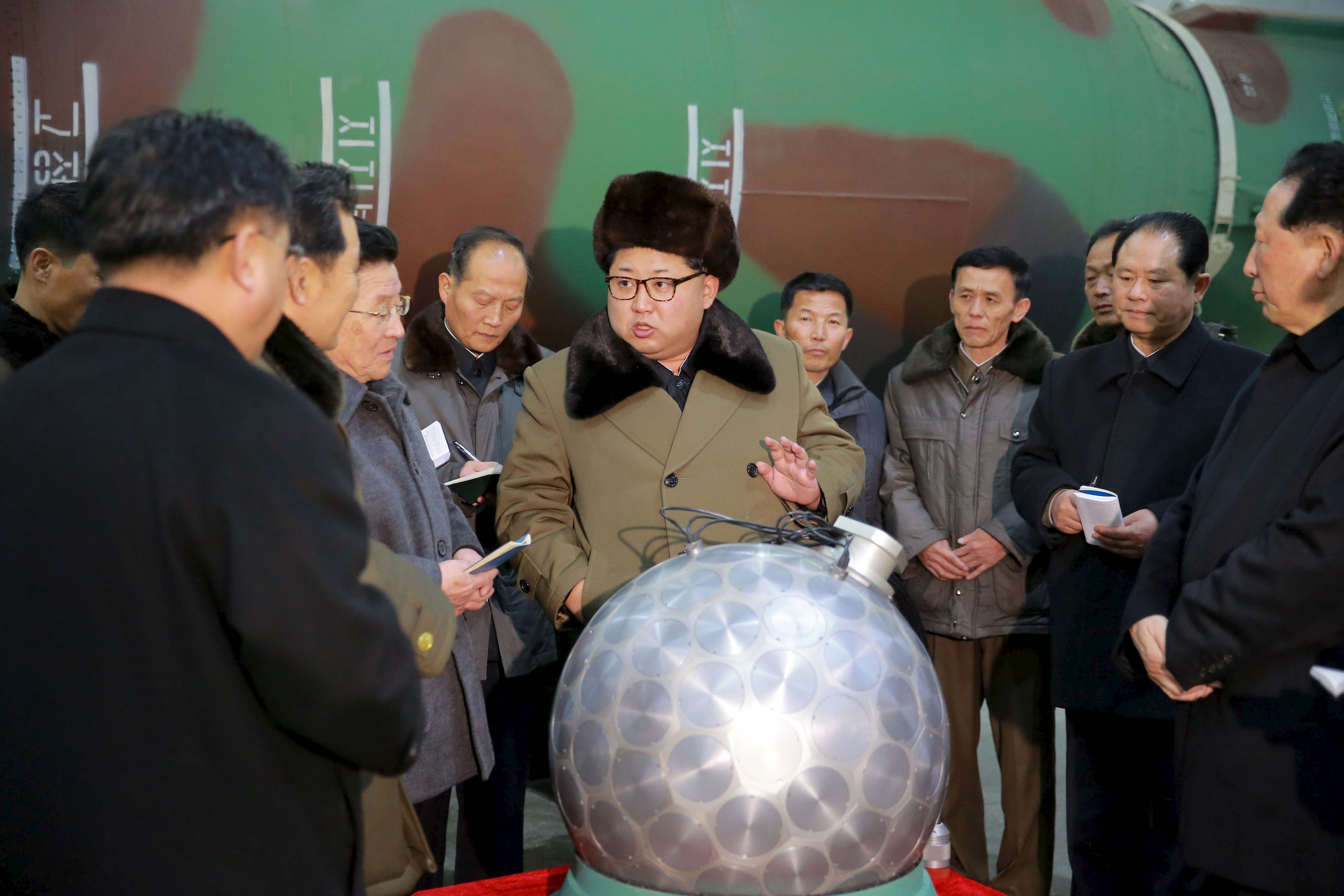 North Korean leader Kim Jong Un meets scientists and technicians in this undated photo released by North Korea's Korean Central News Agency (KCNA) in Pyongyang March 9, 2016