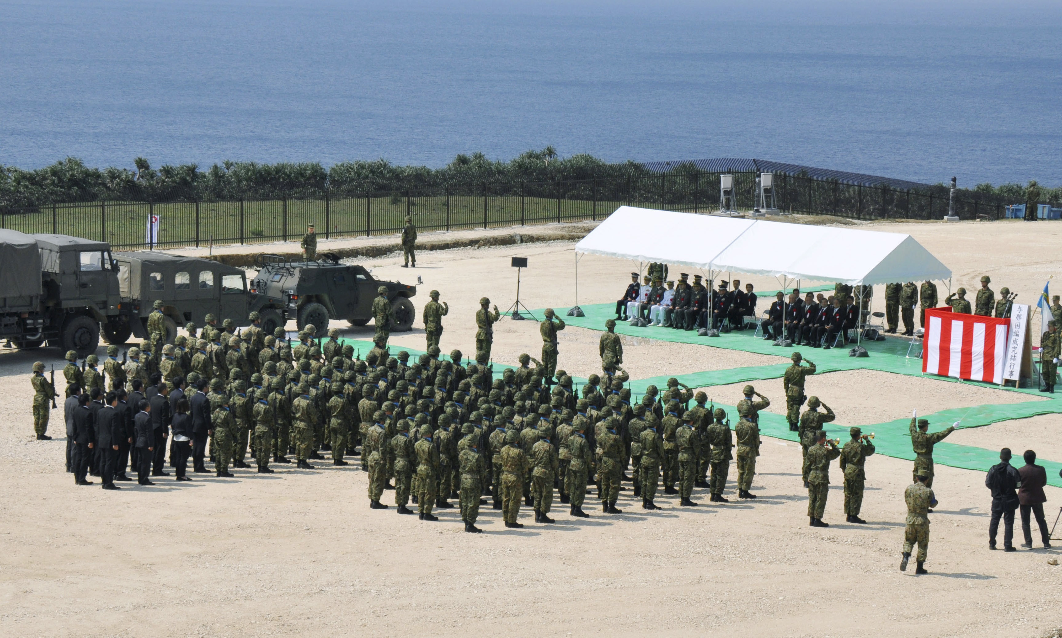 Members of Japan's Self Defence Force hold an opening ceremony of a new military base on the island of Yonaguni in the Okinawa prefecture, March 28, 2016