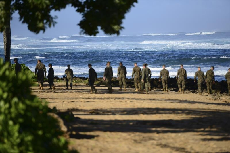 Marines scour a Hawaiian beach in January, seeking evidence of a midair collision between two Marine choppers that killed 12.