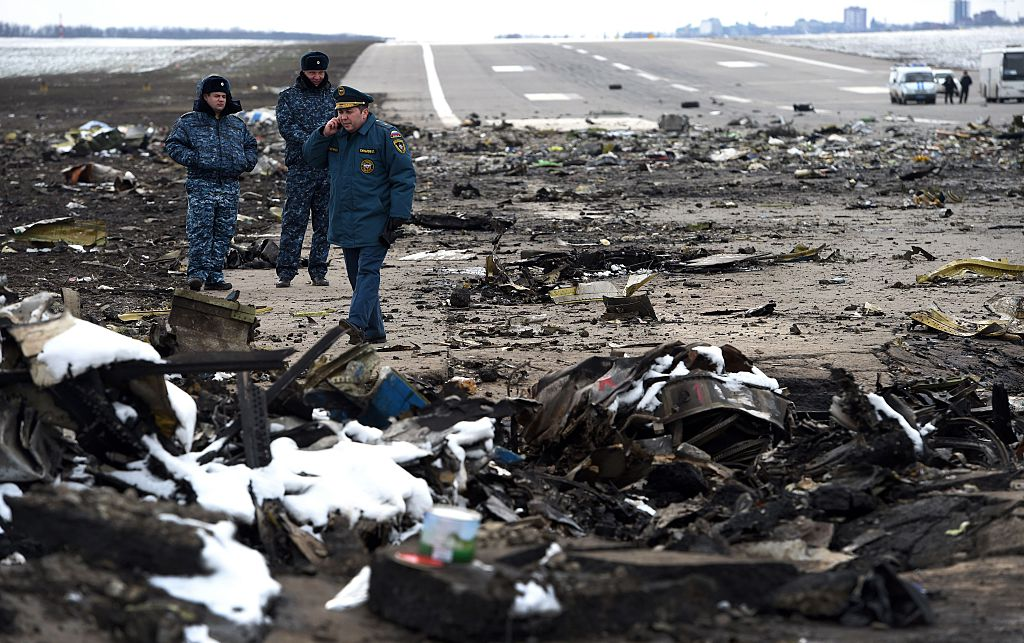 Russian Emergency Ministry rescuers examine the wreckage of a crashed airplane at the Rostov-on-Don airport on March 20, 2016.