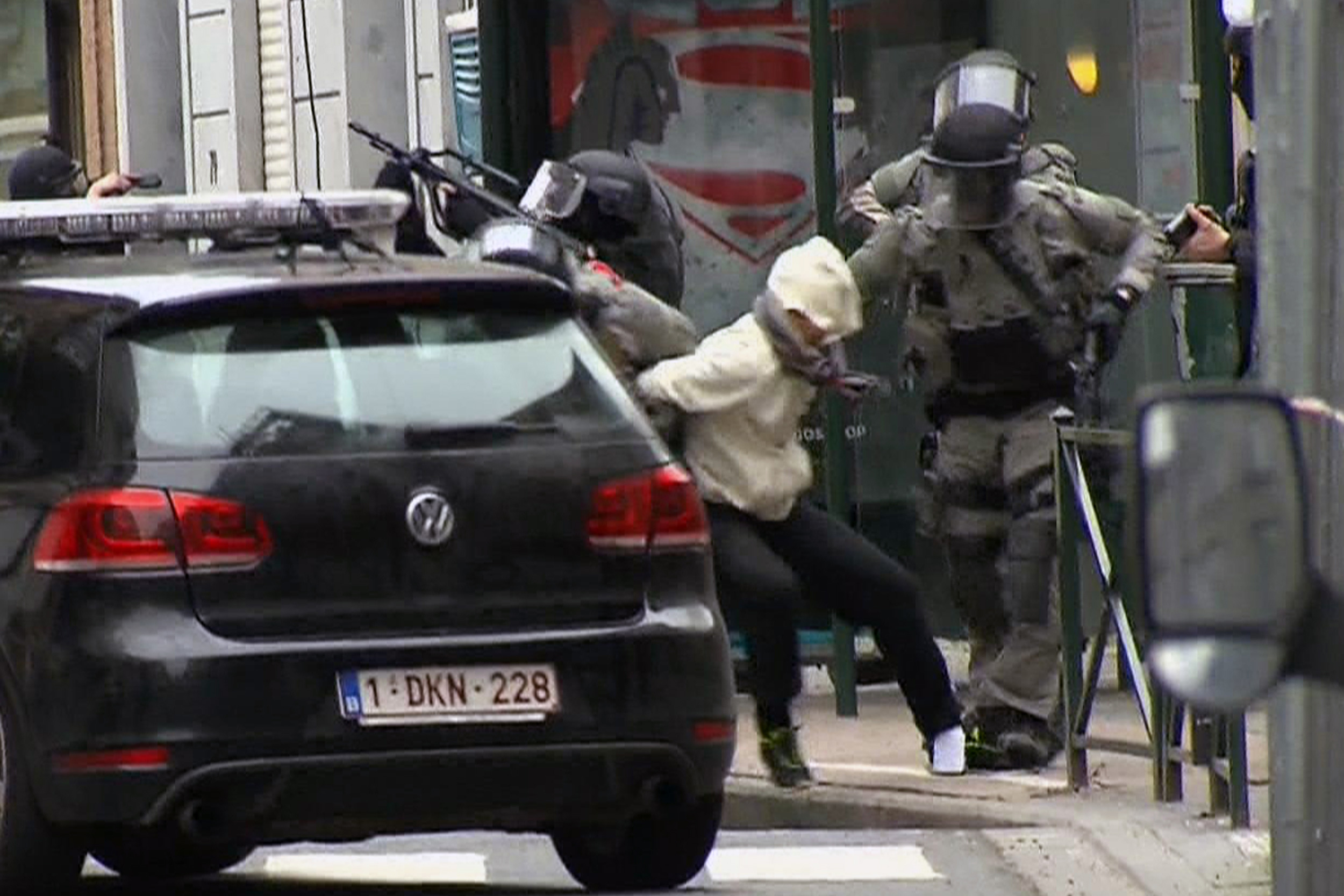 In this framegrab taken from VTM, something appears to drop from inside the pant leg of Salah Abdeslam as he is arrested by police during a raid in the Molenbeek neighborhood of Brussels, Belgium, March 18, 2016.