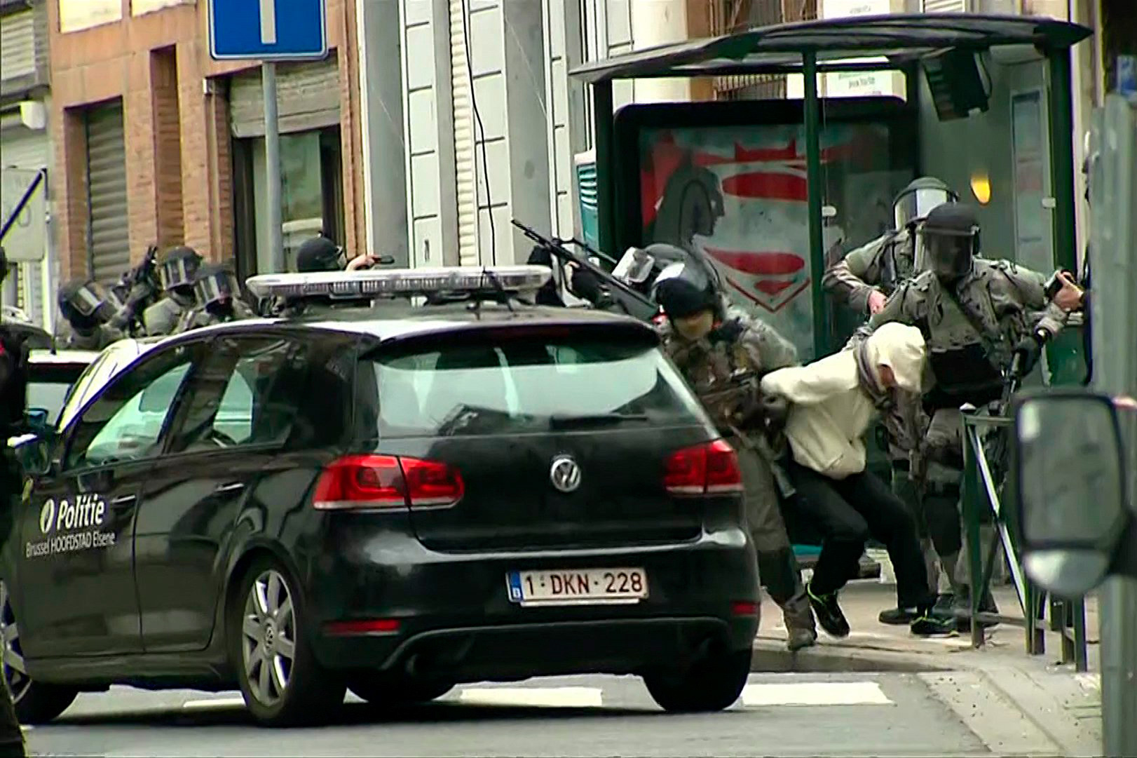 In this still image taken from video footage, armed Belgian police apprehend a suspect later identified as suspected Paris attacker Salah Abdeslam in the Molenbeek neighborhood of Brussels, Belgium, March 18, 2016.