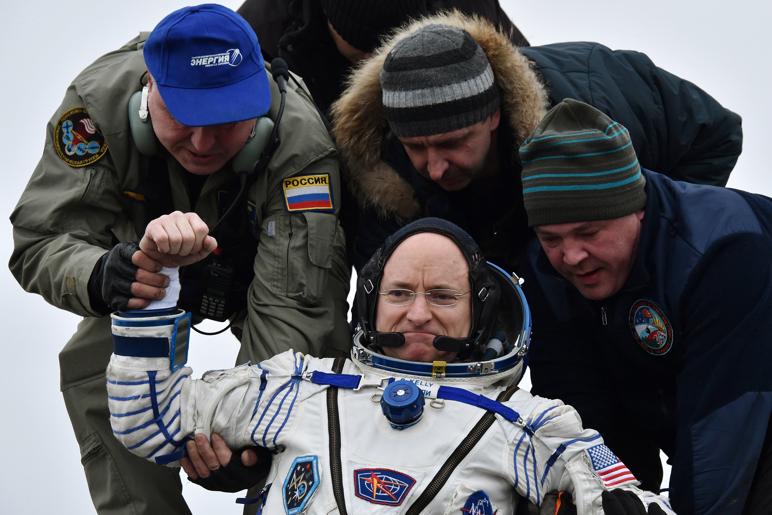 Ground personnel help Scott Kelly get off the Soyuz TMA-18M space capsule after landing in Kazakhstan on March 2, 2016.