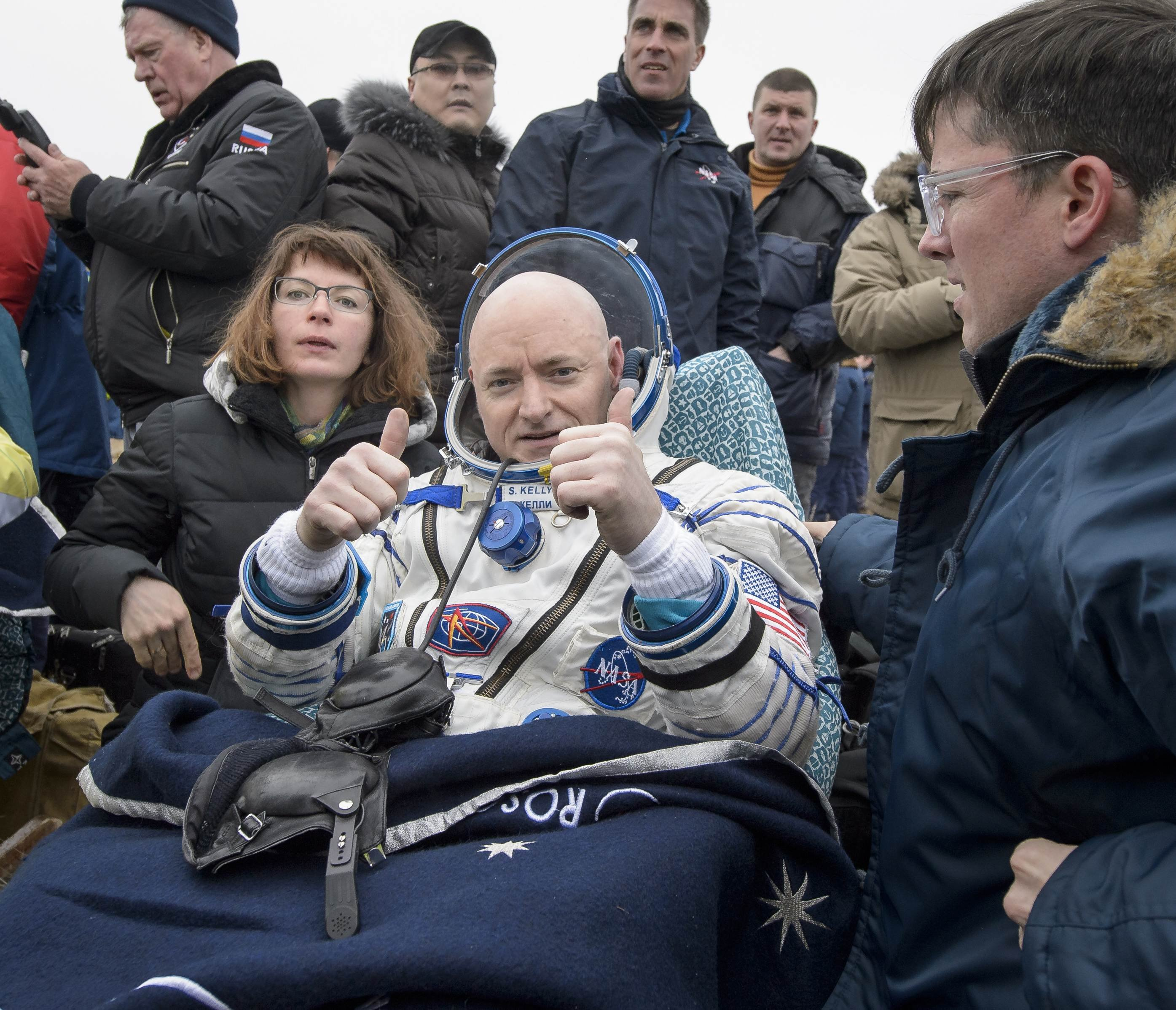Expedition 46 Commander Scott Kelly of NASA rest in a chair outside of the Soyuz TMA-18M spacecraft just minutes after he and Russian cosmonauts Mikhail Kornienko and Sergey Volkov of Roscosmos landed in a remote area near the town of Zhezkazgan, Kazakhstan on March 2, 2016.