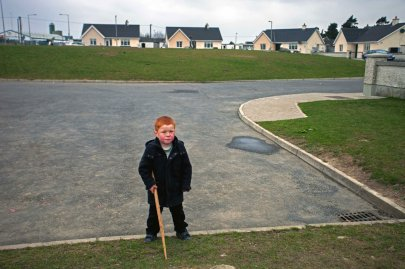 Hebron Road, Co.Kilkenny. A young boy from the Traveller community near his home off the Hebron Road in Kilkenny. Travellers, as individuals and as a group, experience a high level of prejudice and exclusion in Irish society.
