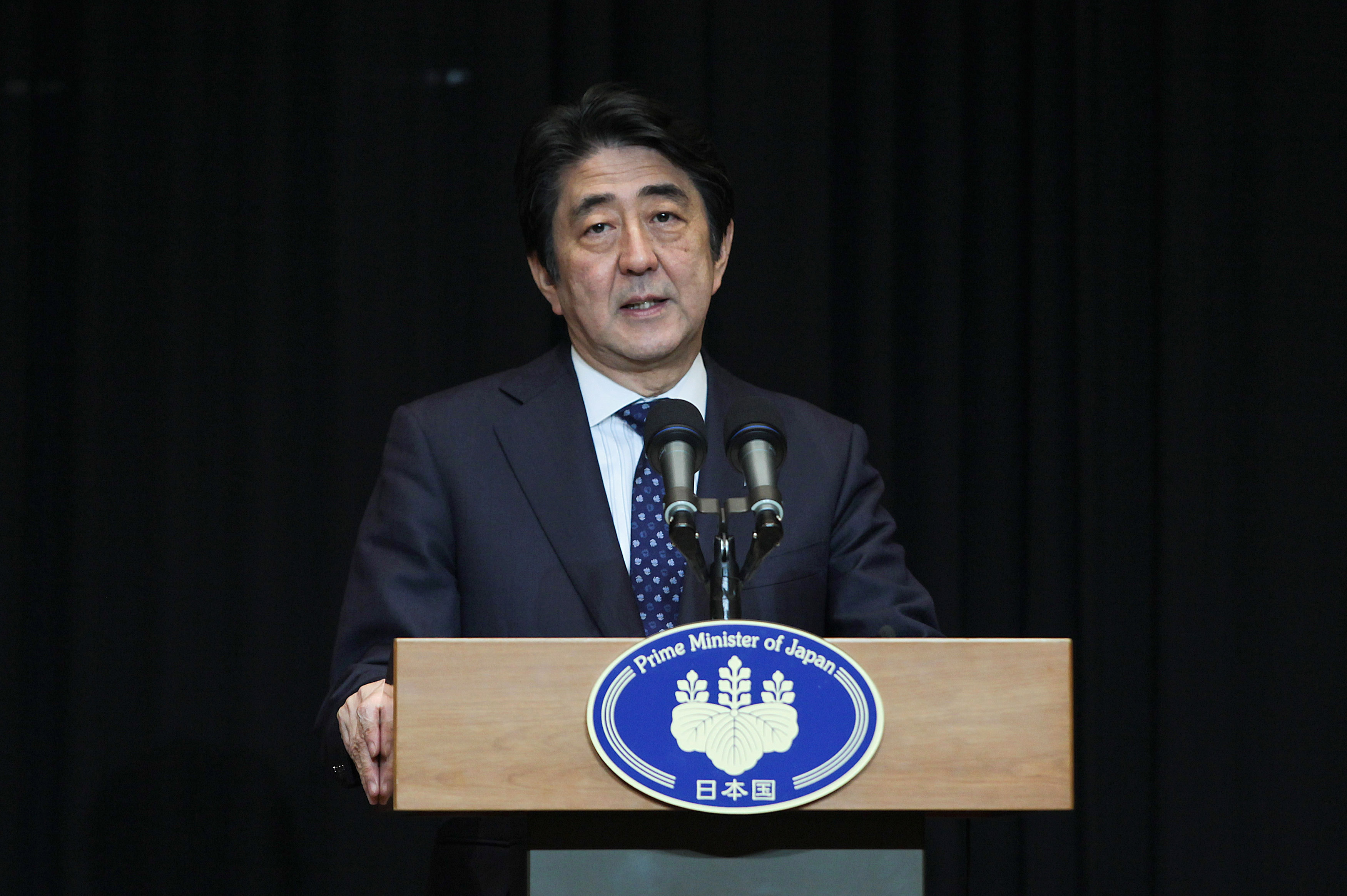 Japanese Prime Minister Shinzo Abe speak to media during a news conference on November 22, 2015 in Kuala Lumpur, Malaysia.