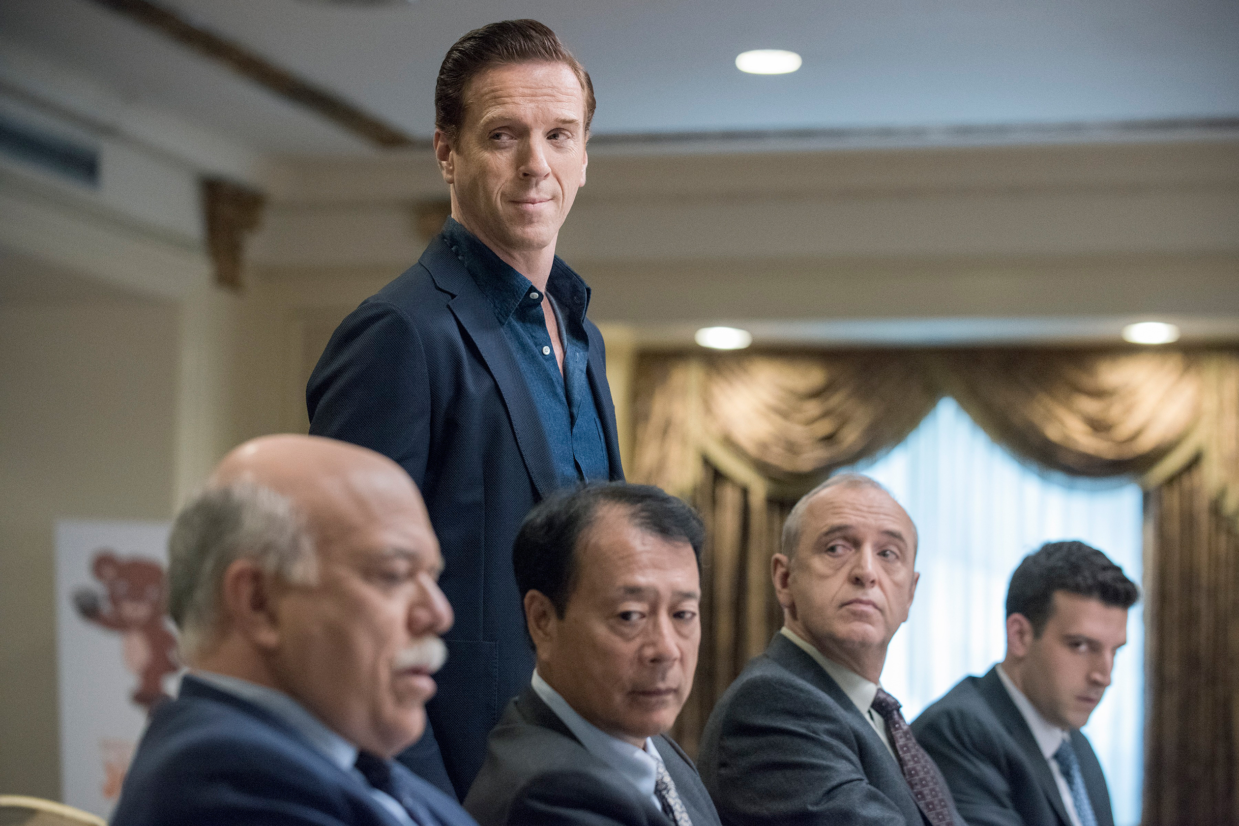 "Damian Lewis, standing, plays the rapacious hedge funder Bobby ""Axe"" Axelrod in Billions"