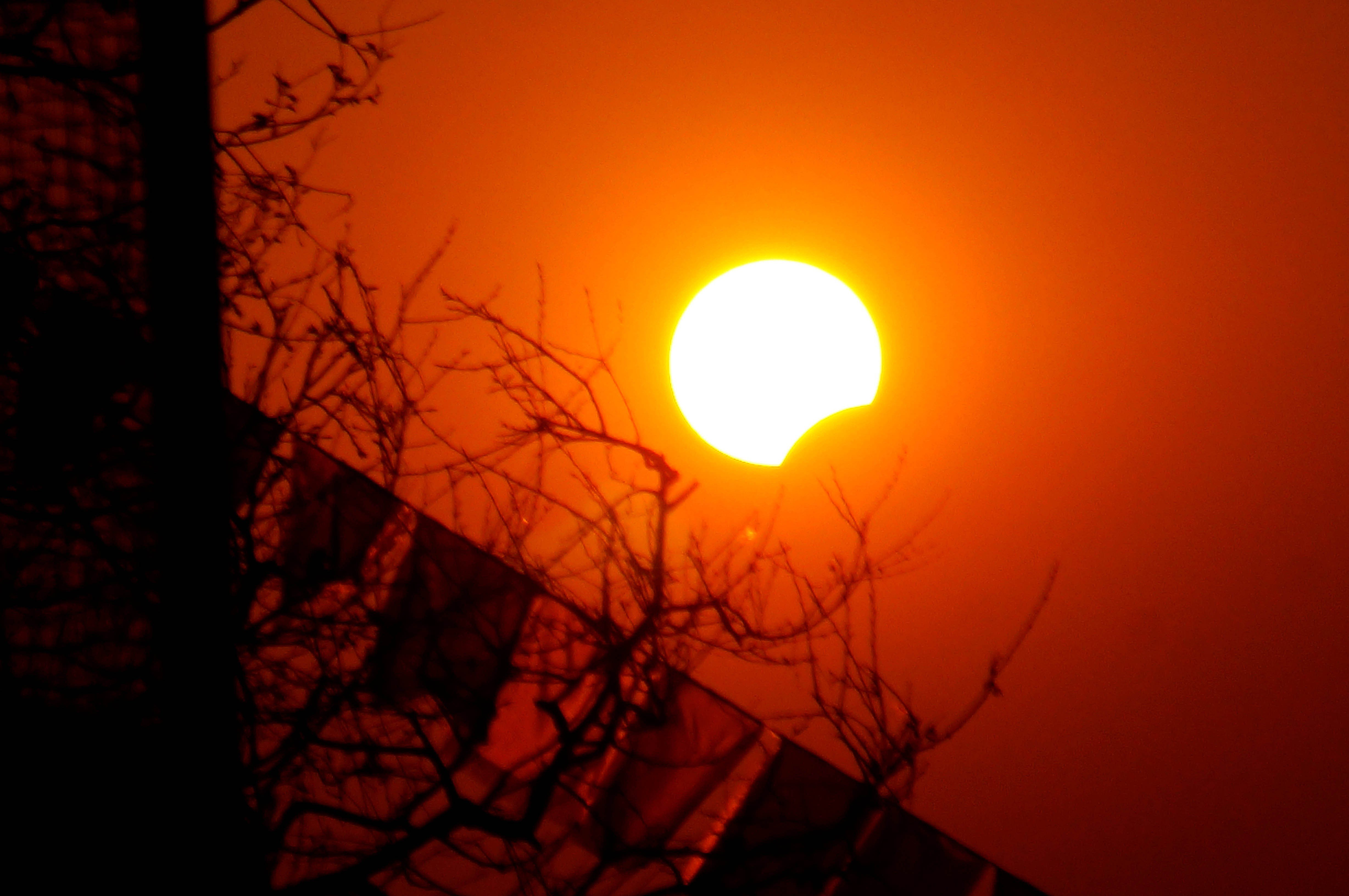 A partial solar eclipse is seen from Kathmandu, Nepal on March 9.