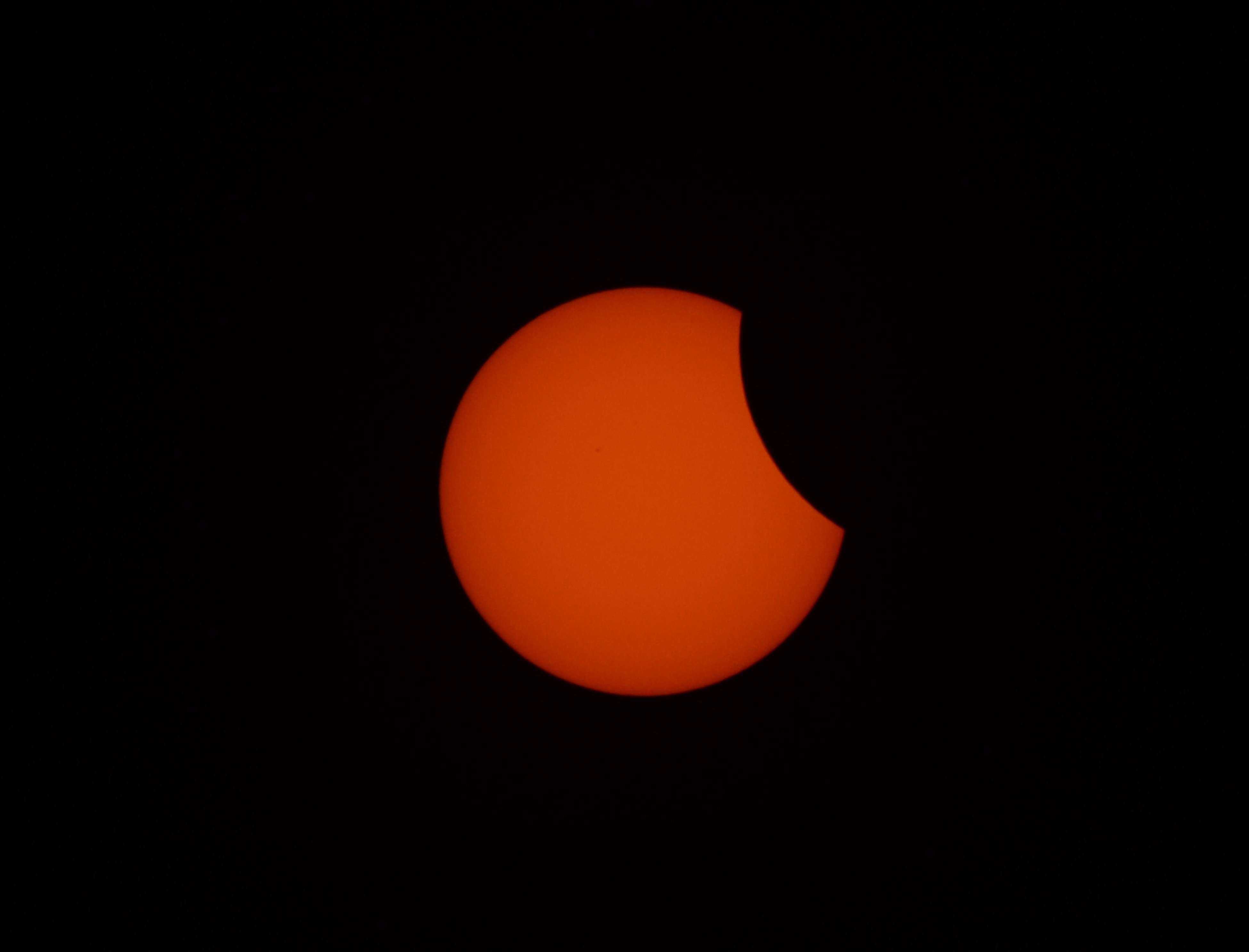 The moon passes in front of the sun during a partial solar eclipse seem from Manila on March 9, 2016.