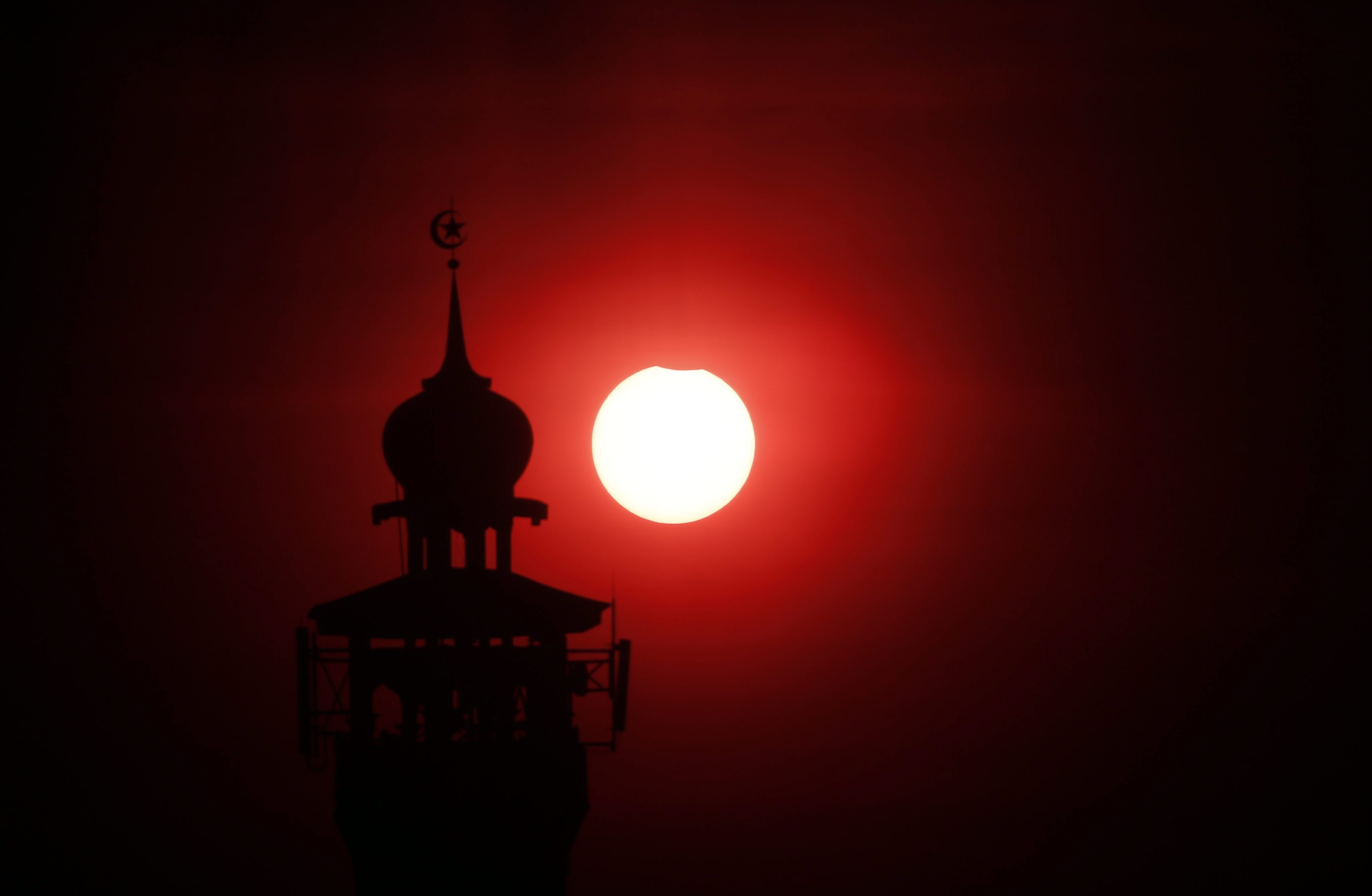 A partial solar eclipse is seen from Jakarta, Indonesia, on March 9, 2016.