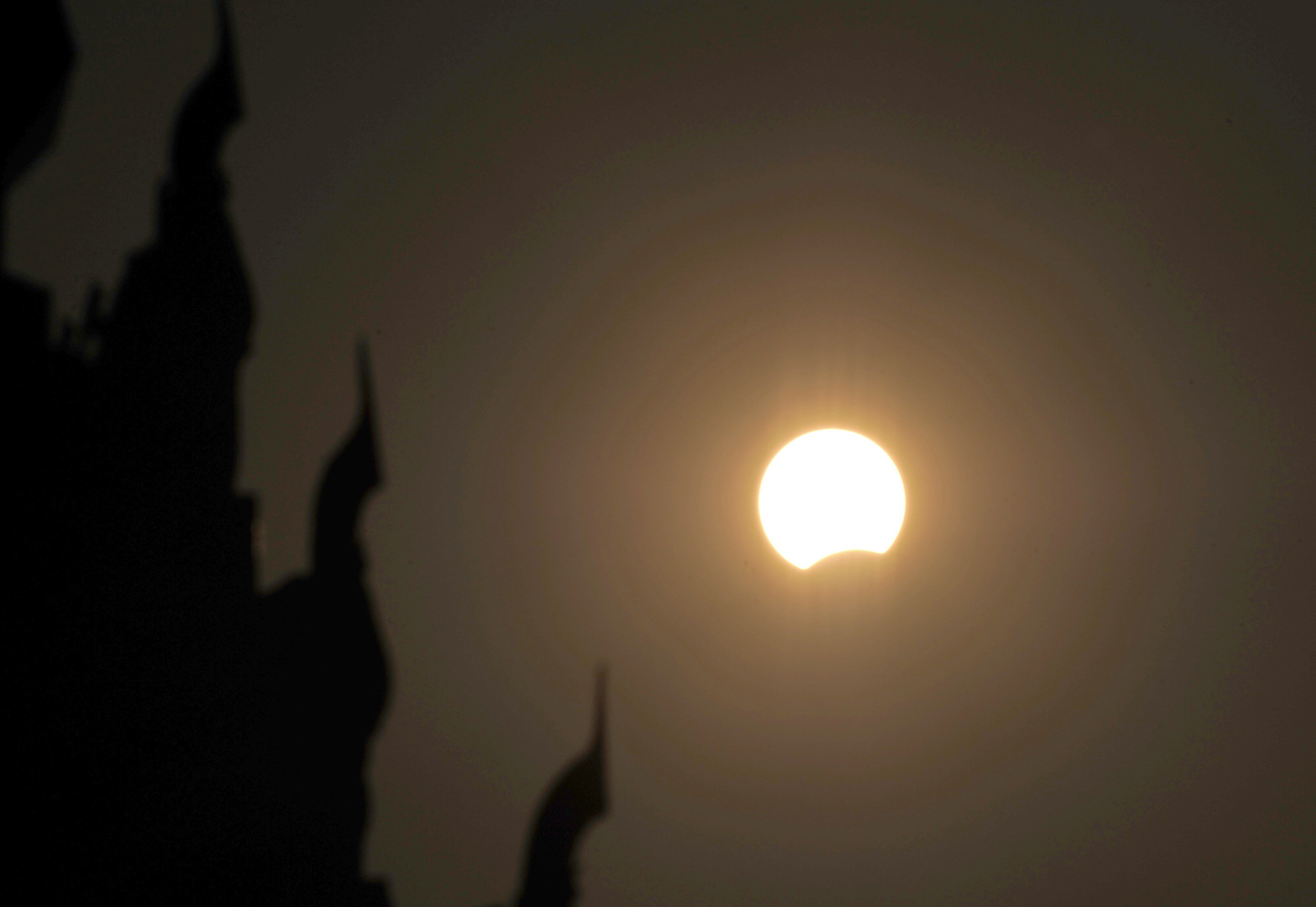 The moon passes in front of the sun during a partial solar eclipse seen from Naypyidaw on March 9.